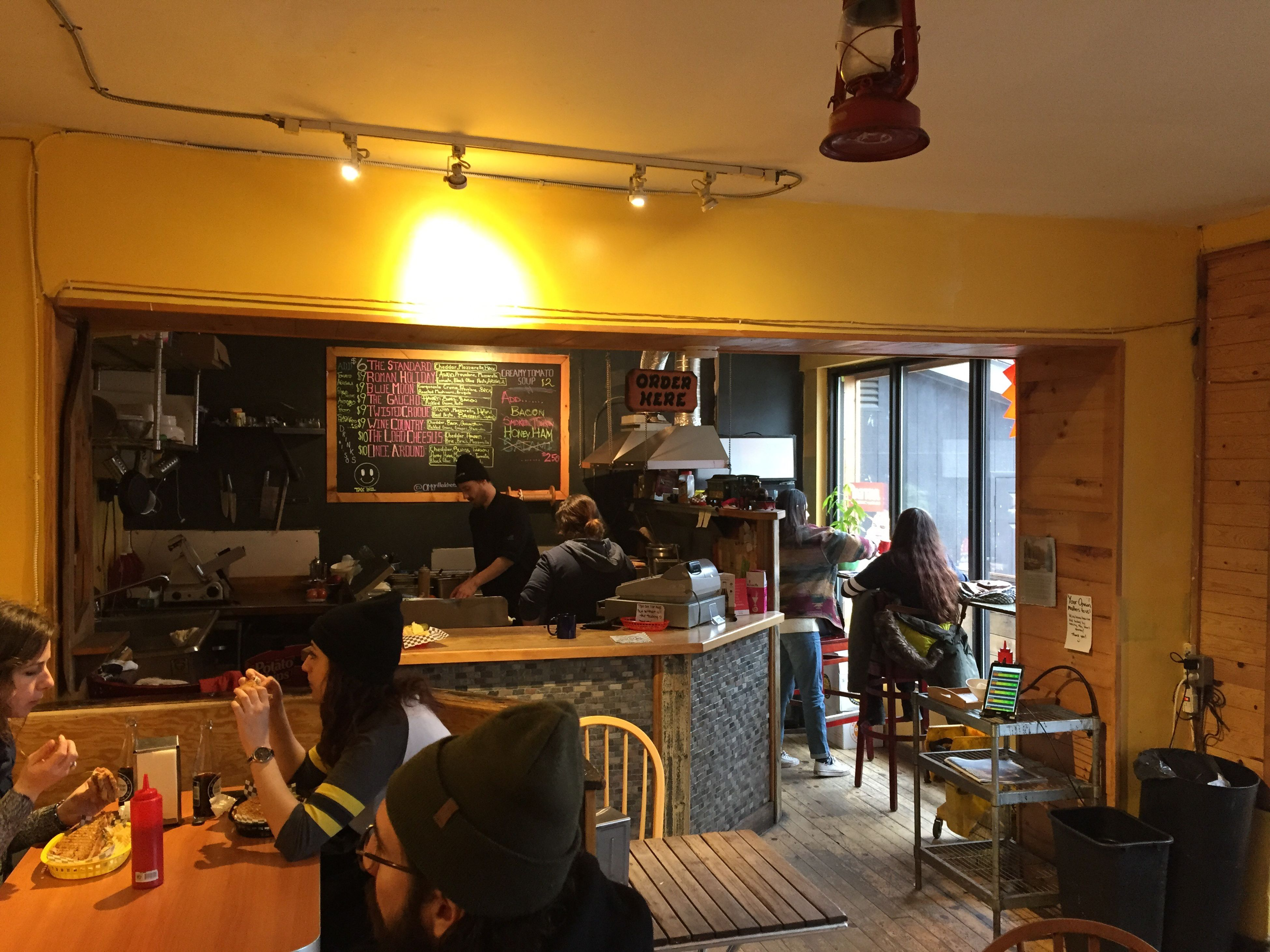 table, indoors, men, food and drink, restaurant, chair, lifestyles, architecture, person, built structure, leisure activity, food, arrangement, retail, illuminated, large group of objects, cafe, variation