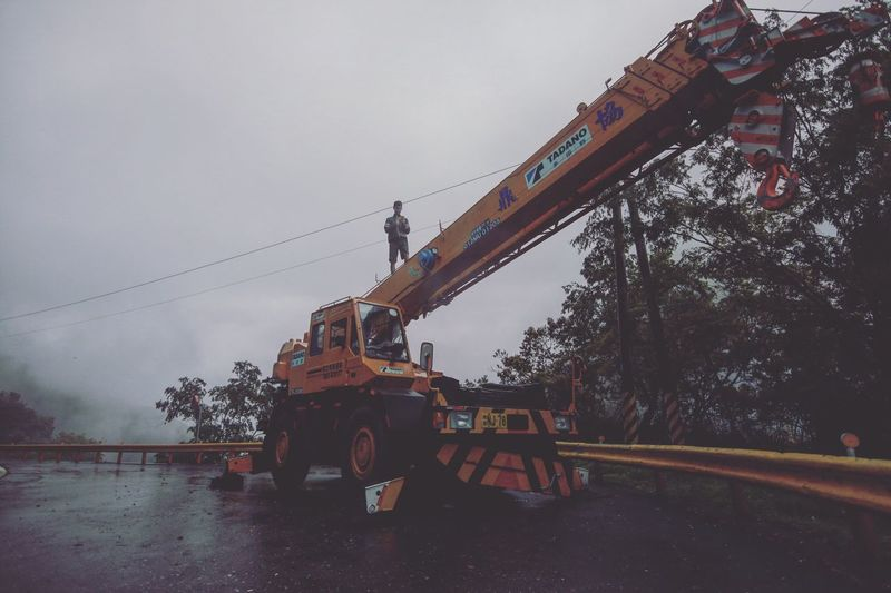 Construction Site Earth Mover Land Vehicle Construction Machinery Transportation Machinery Mode Of Transport Sky Day Road Outdoors No People Industry Architecture