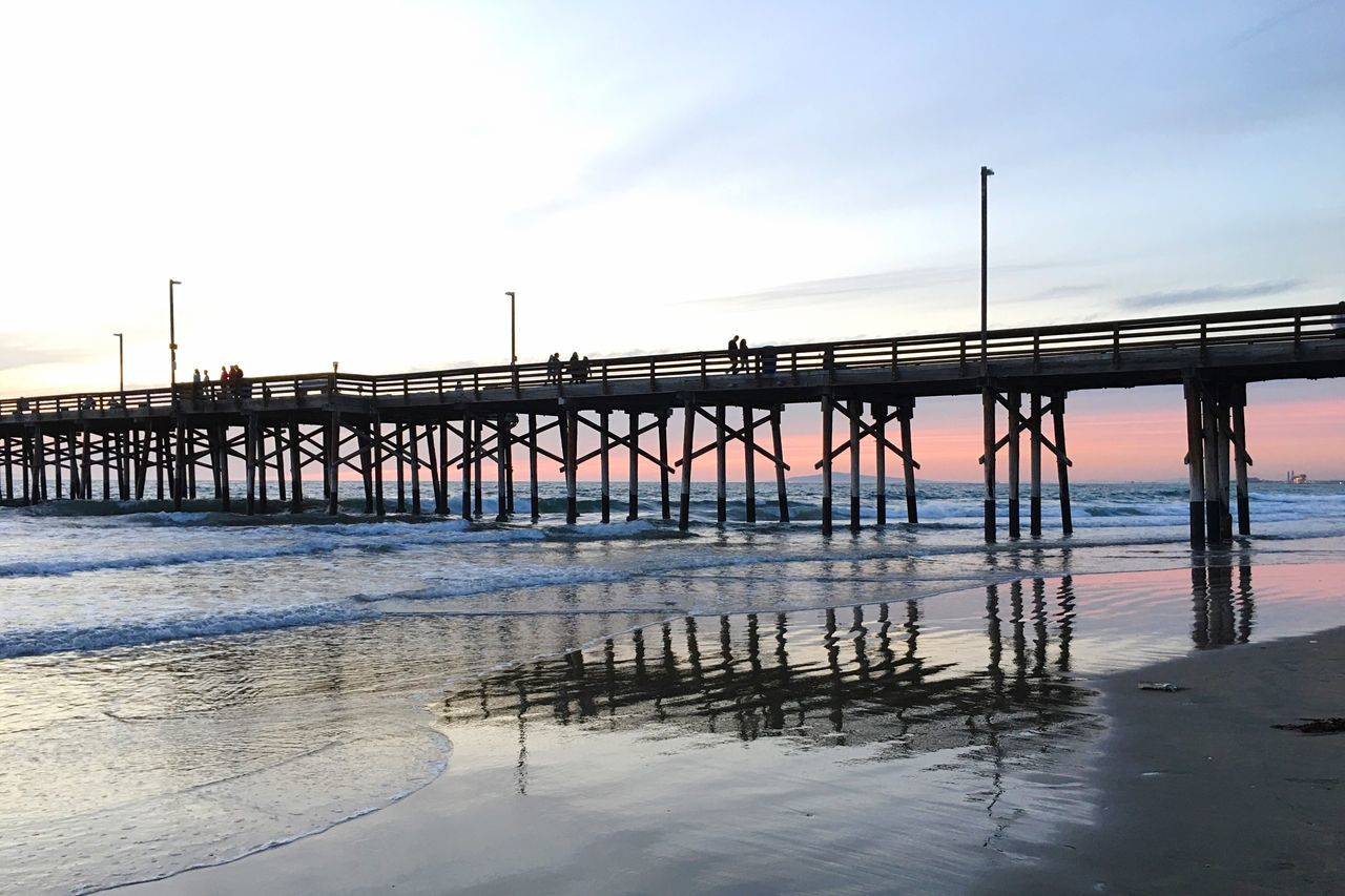 Horizons Water Sky Pier-man Made Structure Sunset_collection Reflections In The Water Beach Photography Built Structure Architecture Outdoors Nature Connection Beauty In Nature Sea Beach Day Winter No People Bridge Cloud - Sky