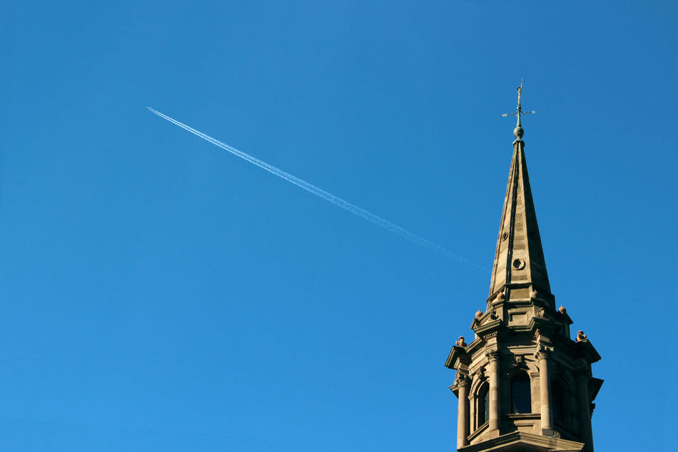Airplane Architectural Column Architecture Blue Building Exterior Built Structure Clear Sky Copy Space Famous Place High Section History International Landmark Low Angle View Monument No People Outdoors Place Of Worship Spire  Steeple Tall Tall - High The Past Tourism Travel Destinations Vapor Trail