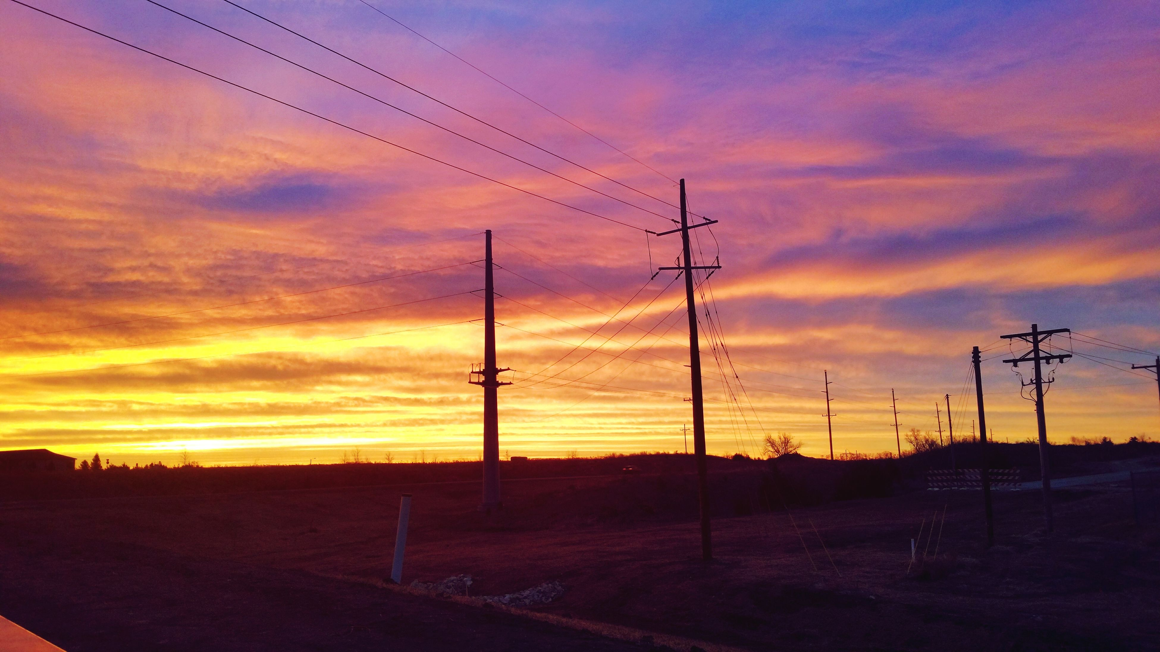 sunset, orange color, sky, silhouette, landscape, cloud - sky, scenics, beauty in nature, cloud, tranquility, bird, field, dramatic sky, nature, tranquil scene, electricity pylon, animal themes, fuel and power generation, power line, outdoors
