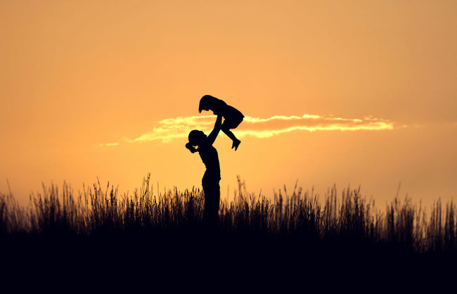 Beauty In Nature Camera - Photographic Equipment Enjoyment Freedom Full Length Fun Idyllic Kid Landscape Leisure Activity Life Lifestyles Love Mother Nature Orange Color Outdoors Scenics Silhouette Sky Success Sunset Tranquil Scene Tranquility Woman