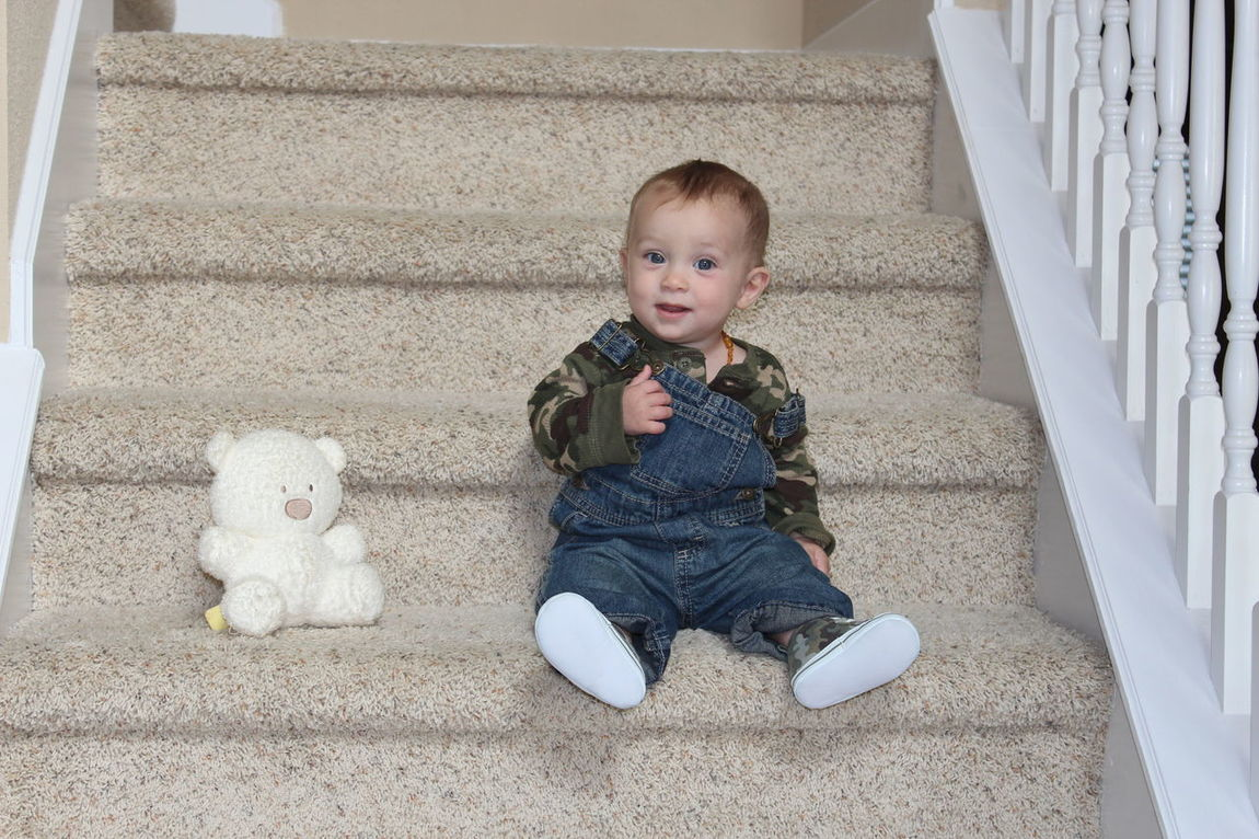 Baby Baby Boys Baby Clothing Casual Clothing Childhood Cute Day Elementary Age Front View Full Length Grandson High Angle View Indoors  Innocence Leisure Activity Lifestyles Looking At Camera New Life Person Portrait Stairs Toddler