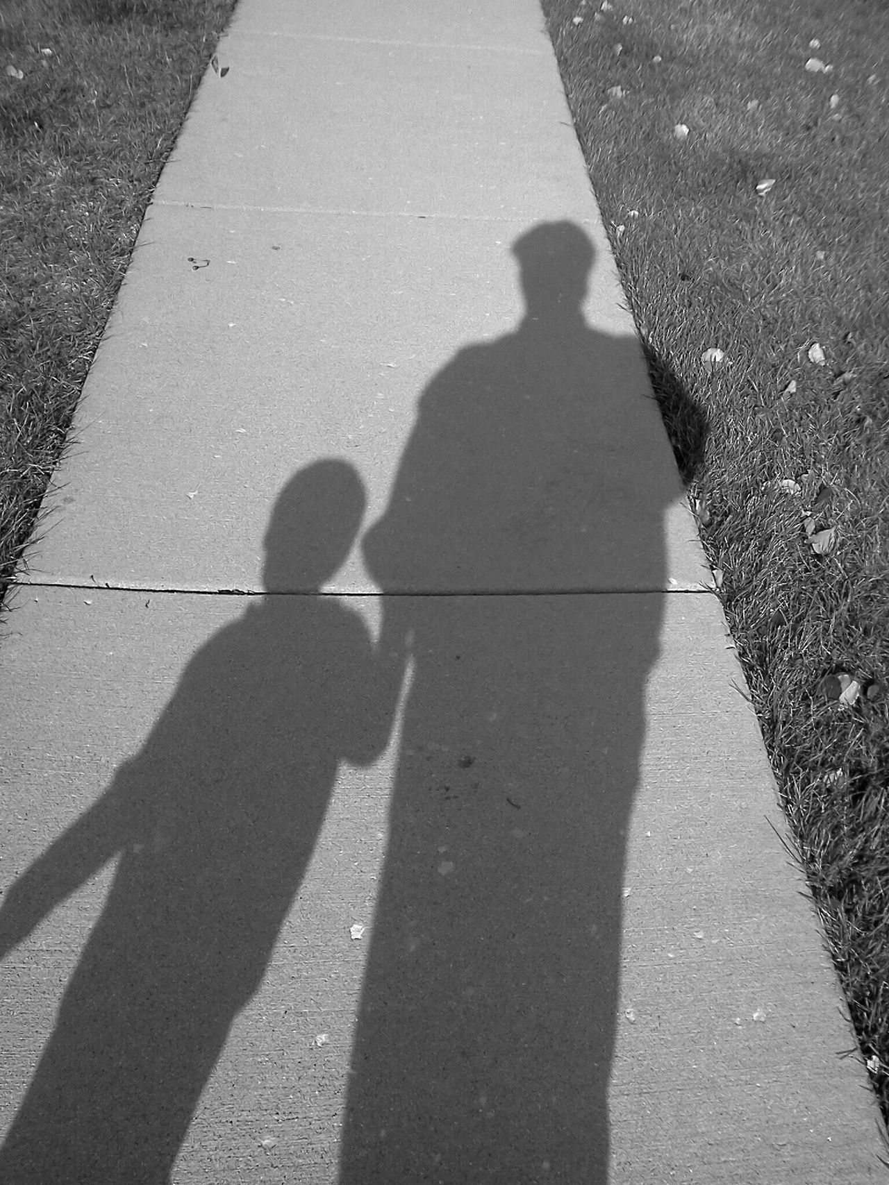 Father and son shadow Black & White Kids My Child Black And White Collection  Shadow Shadows Shadow Photography Childhood Memories Outdoors Summer Childhood Fatherhood  Fatherhood Moments Dad And Son Father And Son Father & Son Walking Hand In Hand Kids Portrait Editorial  Black And White Black&white Blackandwhite Blackandwhite Photography Sidewalk Sidewalk Photograhy