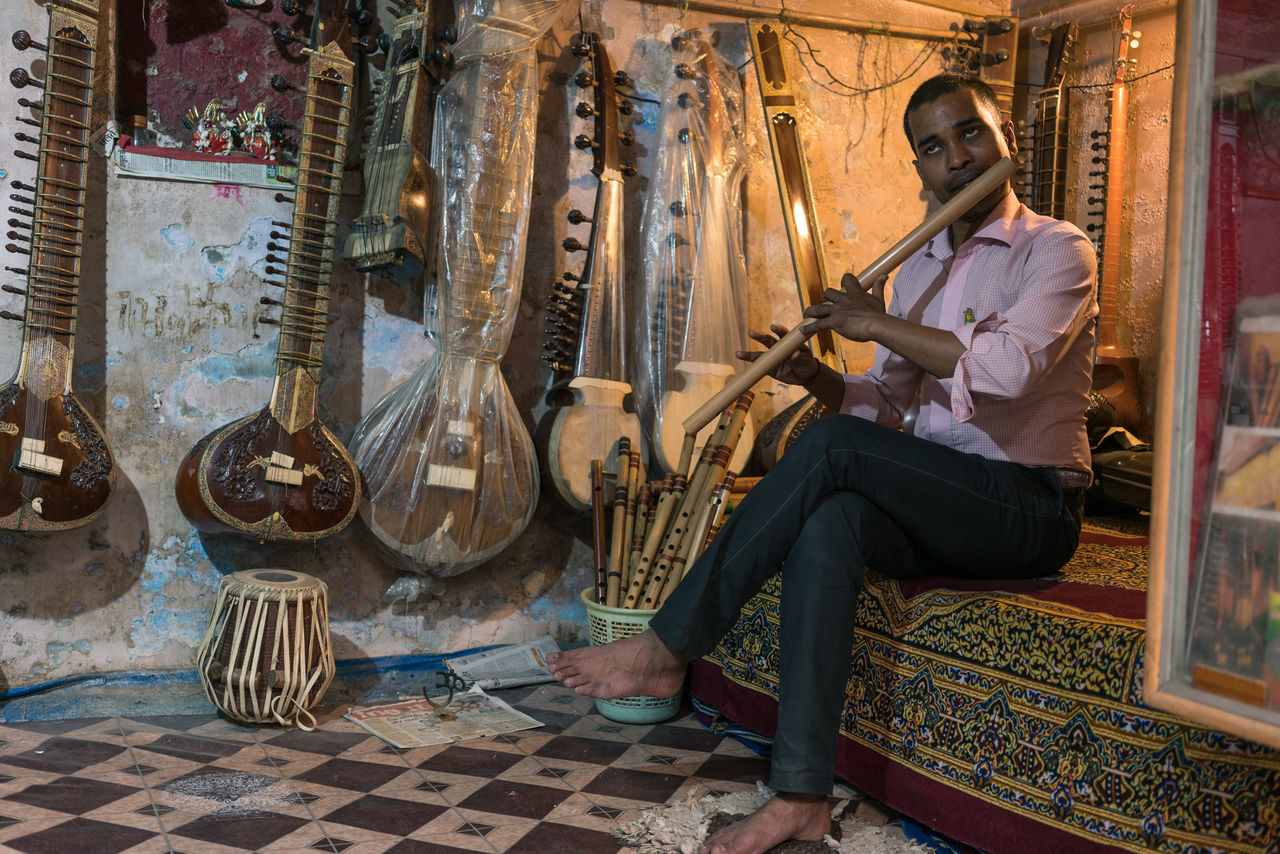 Instrument Salesman, Varanasi Color Color Palette Color Photography Colorful Colours Day India India_clicks Indian Culture  Indianstories Indiapictures Indoors  Musical Instrument Musician One Man Only Real Life Real People Real People Photography Street Photography Travel Travel Destinations Travel Photography Travelphotography Varanasi Varanasi India