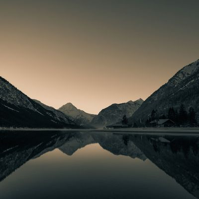 Alpine glow at the Plansee in Austria Sunset Lake Reflection Mountain Sunset Nature Landscape Sky Beauty In Nature Winter Water No People Scenics