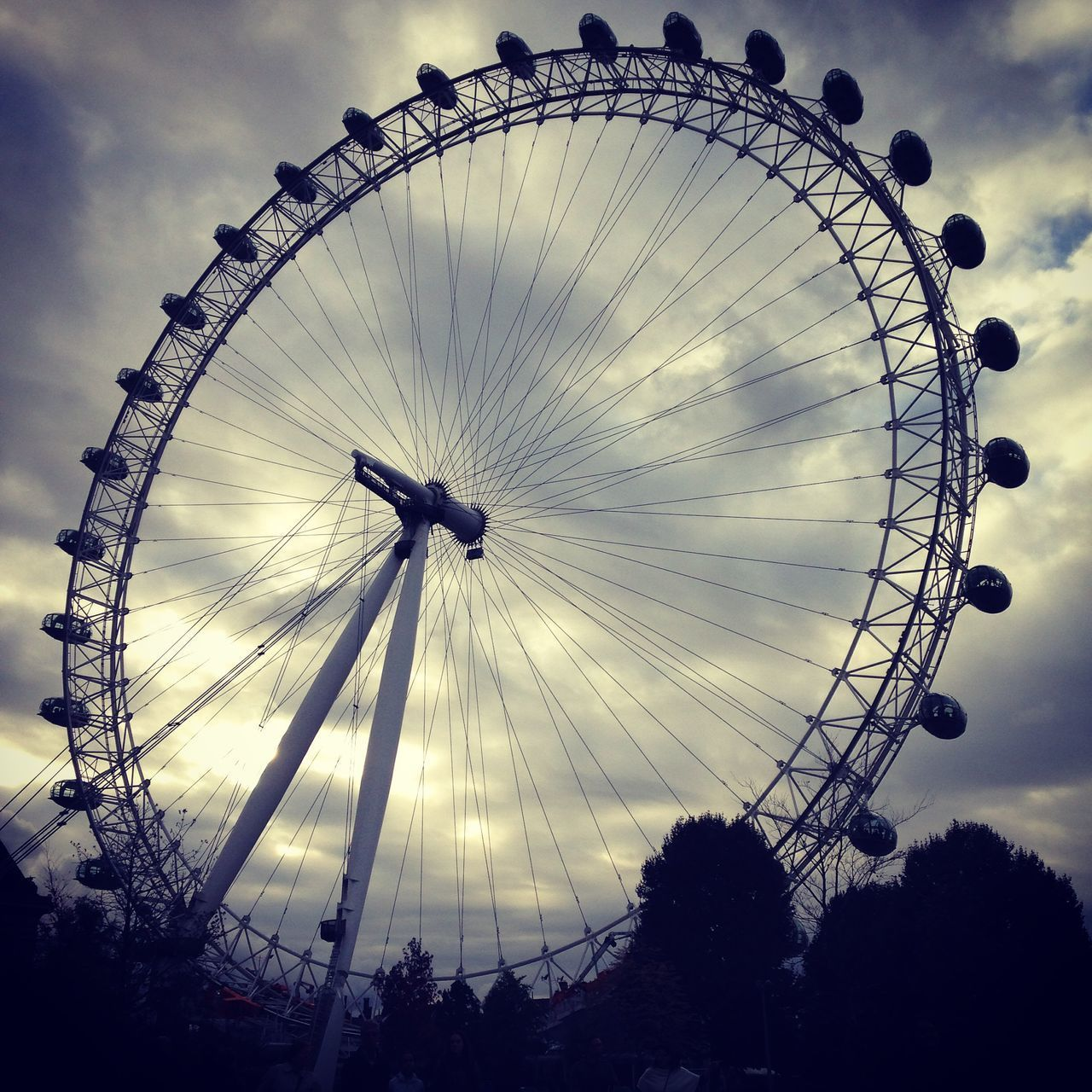 amusement park, ferris wheel, arts culture and entertainment, low angle view, sky, leisure activity, no people, outdoors, day, big wheel