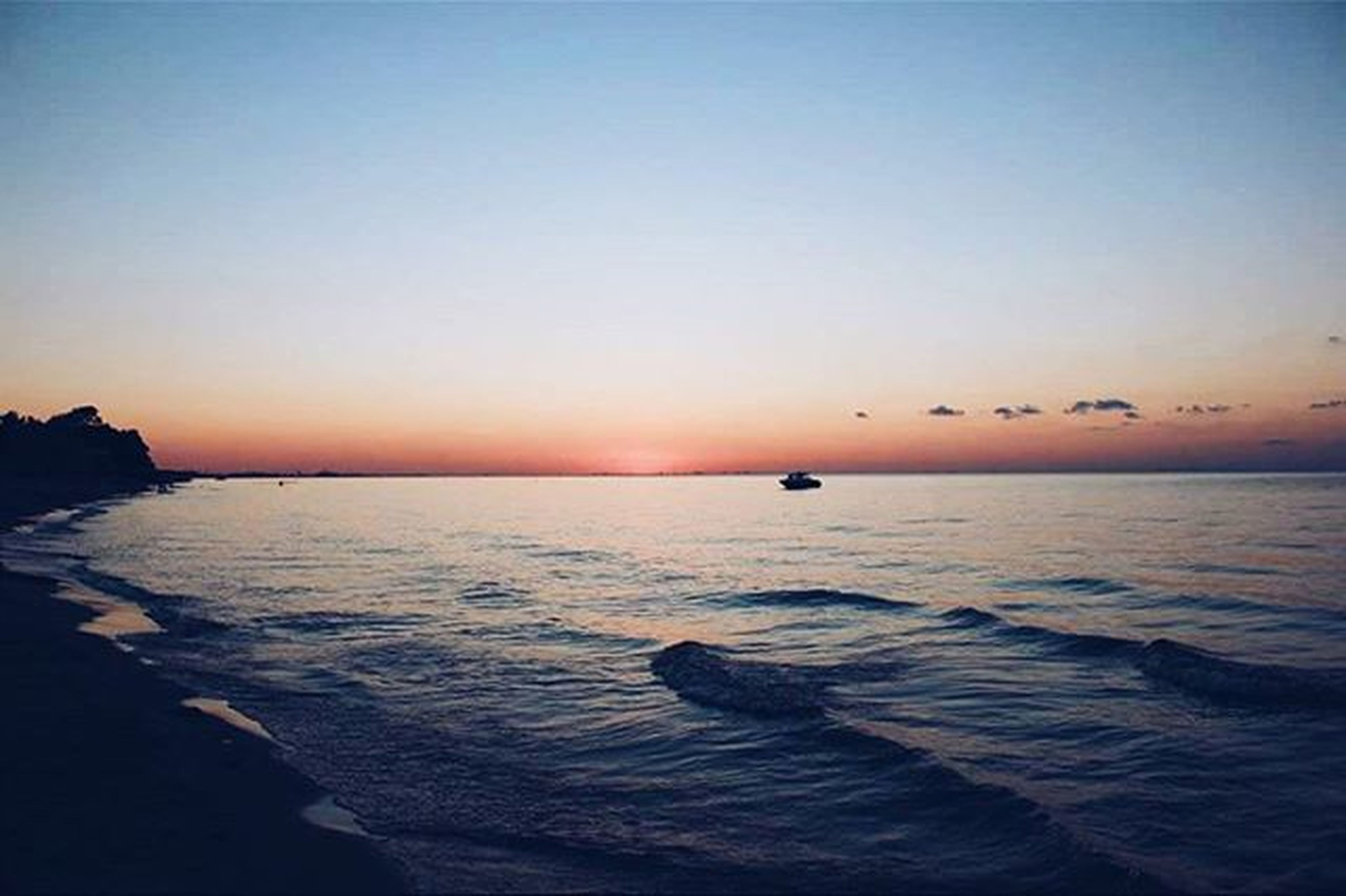 sea, water, horizon over water, sunset, tranquil scene, scenics, clear sky, copy space, tranquility, beauty in nature, nature, idyllic, orange color, rippled, seascape, waterfront, silhouette, sky, dusk, beach
