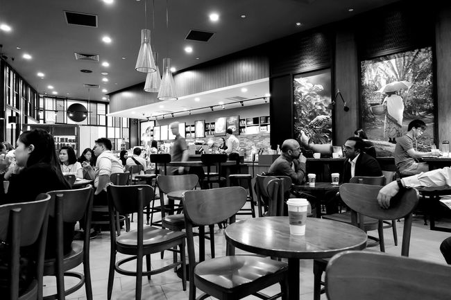 Casual coffee breaks. Arrangement Black & White Blackandwhite Blackandwhite Photography Busy Chair Coffee Dining Dining Table EyeEm Food And Drink Food And Drink Industry Indoors  Men Monochrome Monochrome Photography Outdoor Restaurant Person Photography Photooftheday Restaurant Sitting Table VSCO Vscocam