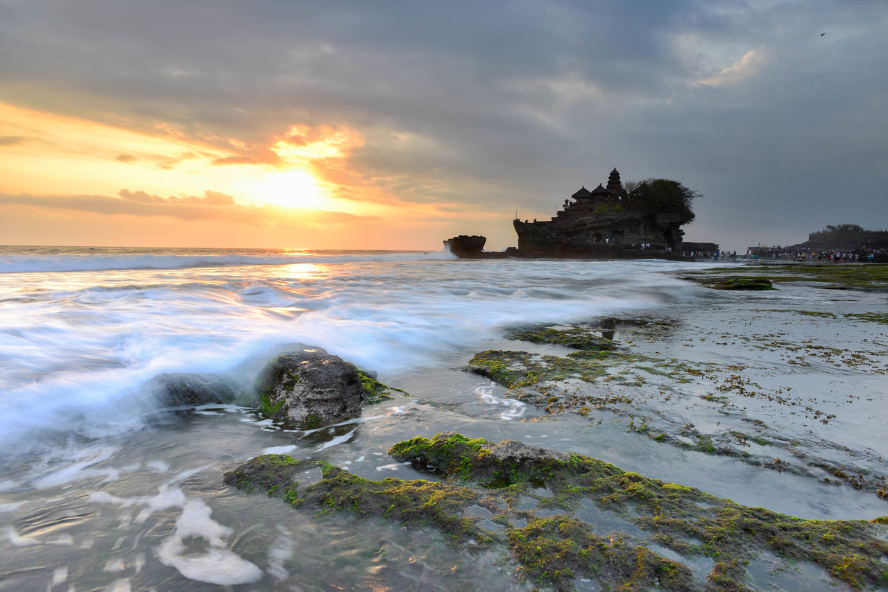 Sunset at Tanah Lot, a popular tourist attraction in Bali, Indonesia. Architecture Bali Beach Clouds Clouds And Sky Cloudscape INDONESIA Island Landscape Moss Nature Outdoors Pura Rock Formation Sea Sunset Sunsets Tanah Lot Temple Tourism Tourist Tourist Attraction  Travel Travel Destinations Waves