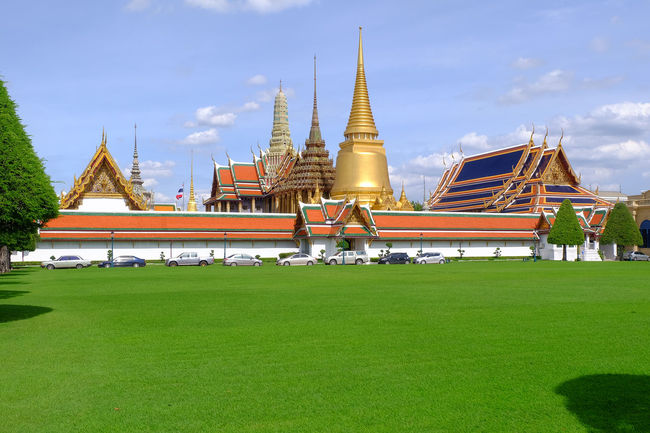 Wat Phra Kaeo temple , landmark of Thailand Ancient Architecture Art Blue Blue Sky Bluesky Building Cloud Grass Green Greensward History Landmark Landscape Lawn Old Religion Royal Royal Palace Sky Temple Thai Architecture Thai Art Tree Wat Phra Kaeo