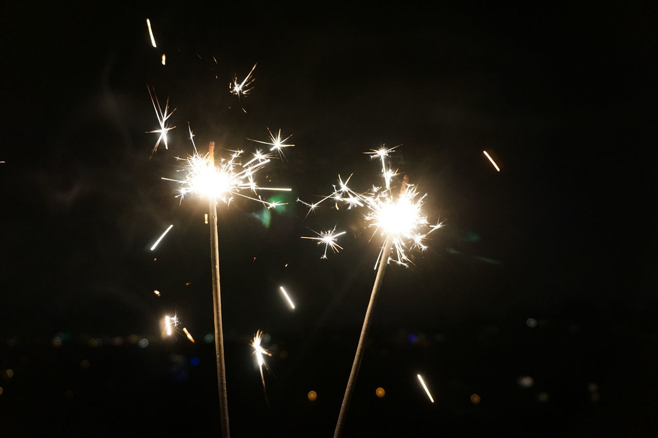 night, firework display, firework - man made object, celebration, exploding, sparks, illuminated, event, long exposure, glowing, arts culture and entertainment, low angle view, motion, sparkler, firework, outdoors, no people, sky