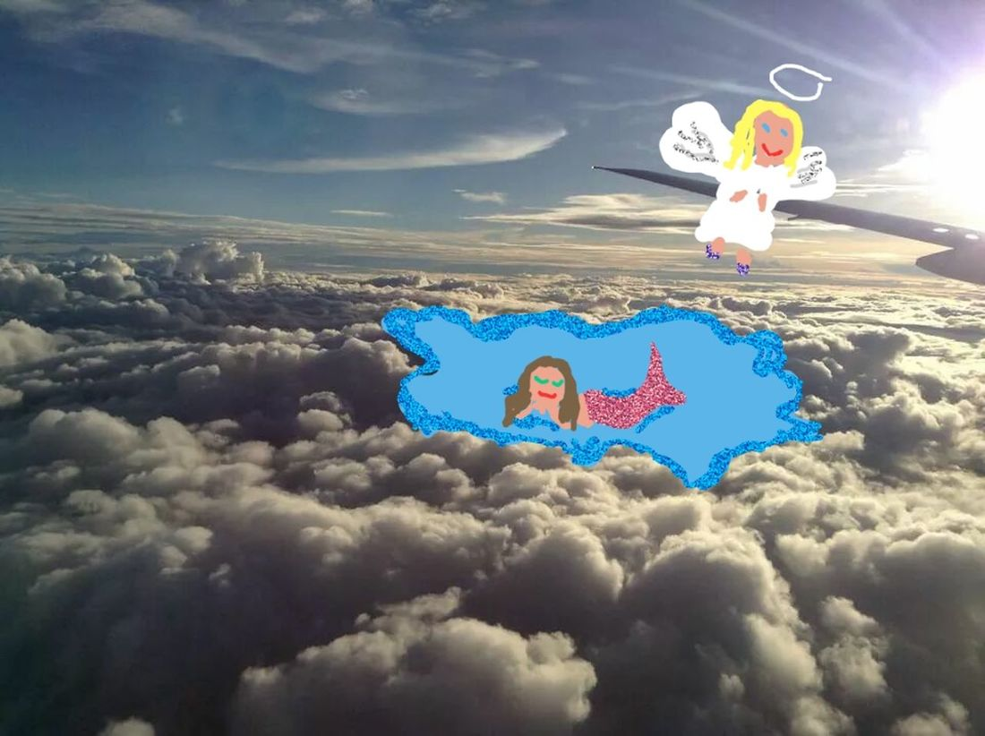 Looking out of the plane's window, guess what I saw? Doodling Doodles Sky ANGEL IN CLOUDS