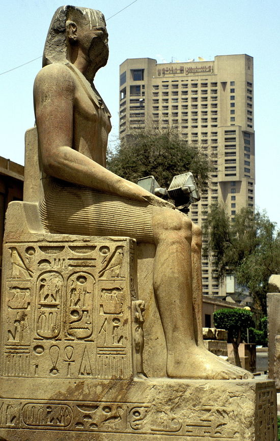 raonic a Amenemhat I Antique And Modern Building Exterior City Day Egyptian Antiques Egyptian Antiquities Egyptian Art Egyptian Statue No People Outdoors Pharaoh Pharaoh Statue Pharaonic Pharaonic Antiques Pharaonic Antiquities Pharaonic Art Pharaonic Sculpture Representing Sculpture Sitting Alone Sitting Pharaoh Sitting Statue Sky Statue