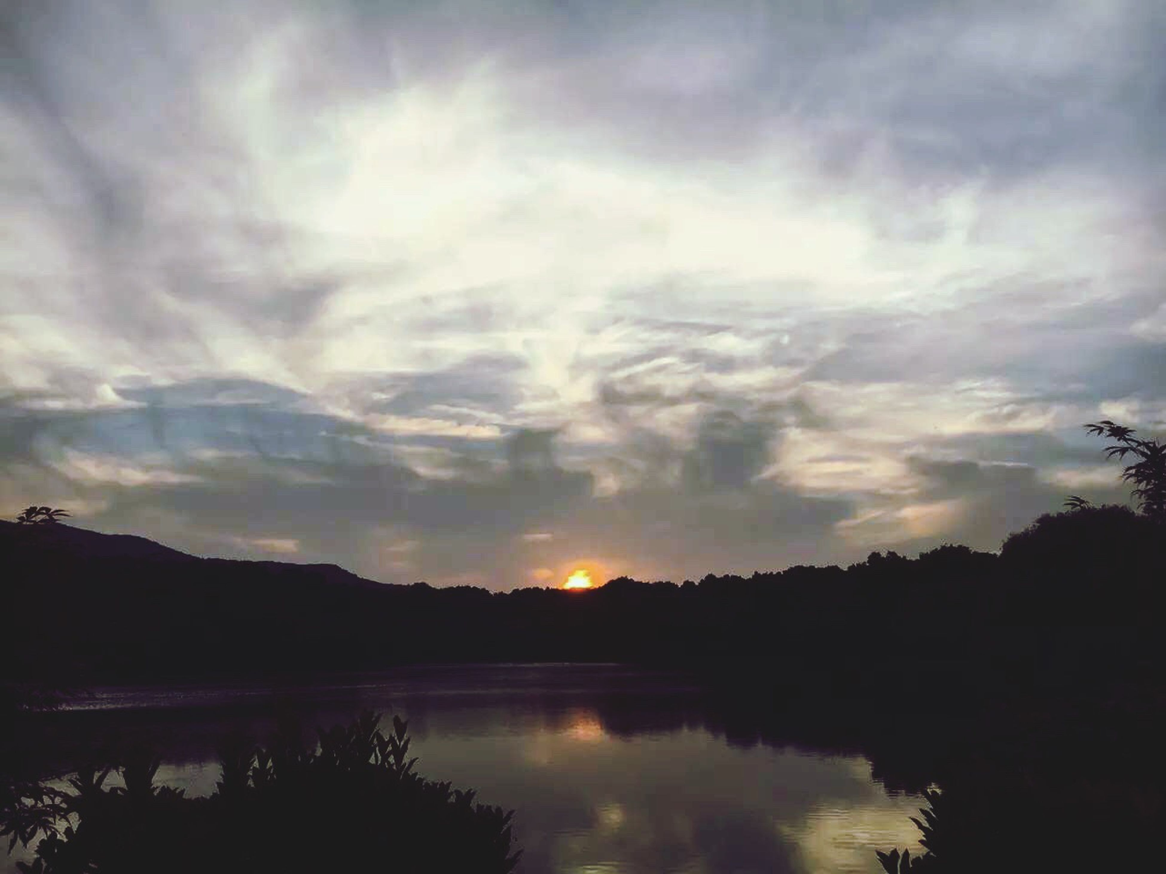 tranquil scene, silhouette, tranquility, sky, scenics, sunset, beauty in nature, water, lake, reflection, cloud - sky, tree, nature, idyllic, cloud, cloudy, calm, non-urban scene, outdoors, dusk