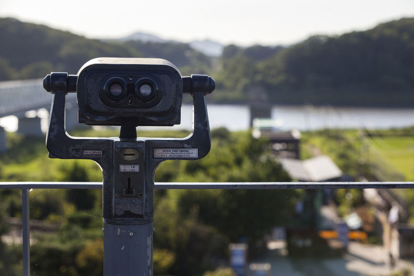 Beauty In Nature Bridge Camera - Photographic Equipment Communication Fence Focus On Foreground Hobbies Imjin River Imjingak Imjingang Man Made Object Mountain Nature Observatory SLR Camera Technology Telescope Water