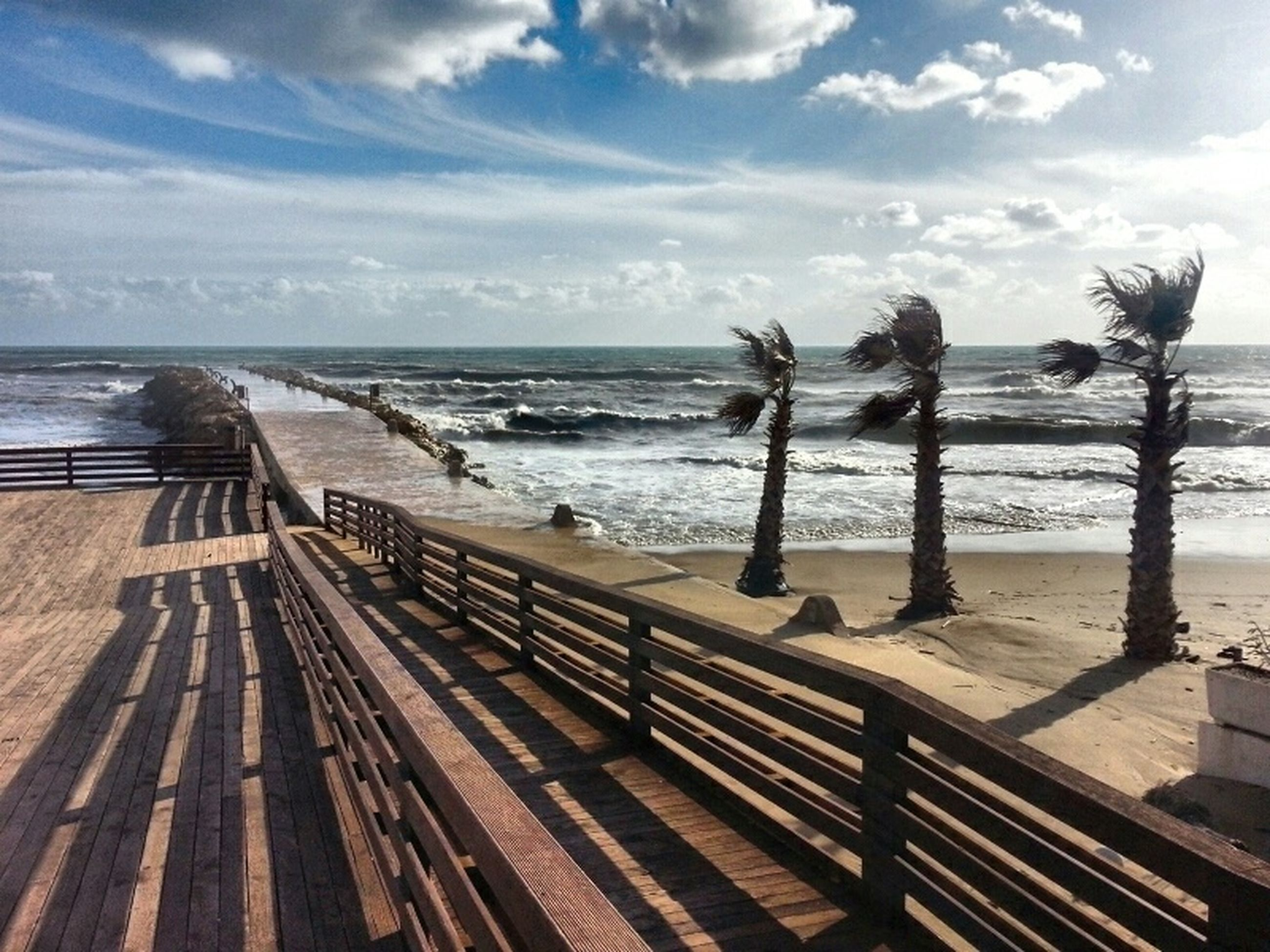 sea, sky, horizon over water, water, beach, cloud - sky, railing, tranquility, tranquil scene, shore, pier, wood - material, nature, scenics, cloud, beauty in nature, sand, the way forward, idyllic, cloudy