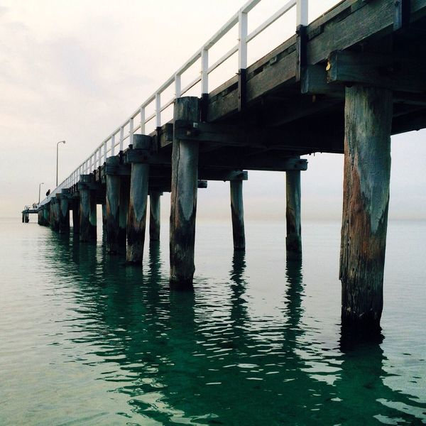 - Pure Pier - Built Structure Architecture Connection Water Low Angle View Waterfront SUPPORT Bridge - Man Made Structure Pier Sea Architectural Column Sky In A Row River Wave Day Nature Below Bridge Beauty In Nature Relaxation Calm Getting Away From It All Green Blue Water Photography