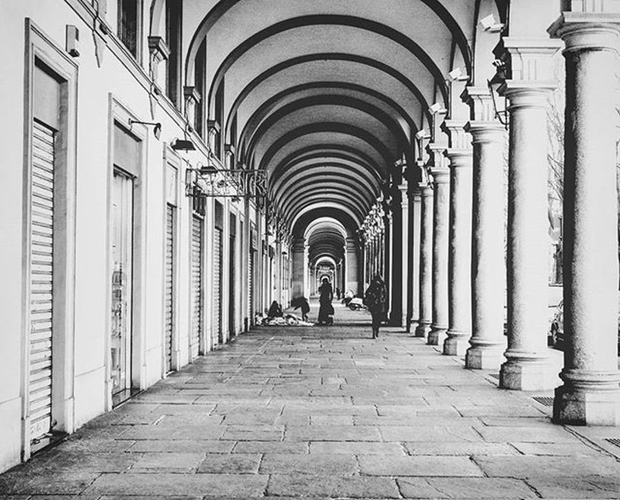 Early morning walking in the turin city center... Shops still closed just a few people around Portici Streetshot Torino Igerstorino Trowback
