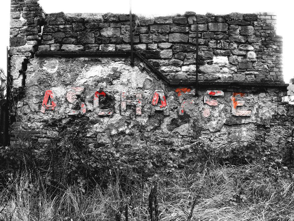 Abandoned Blackandwhite Photography Brick Wall Building Built Structure Close-up Day Destroyed Deterioration Forgotten Places  Grass Loneliness No People Outdoors Red Letters Text Winter Withered Grass