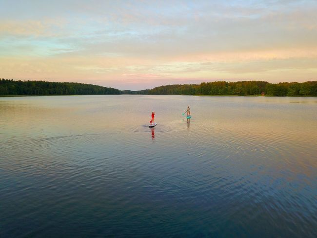 Soft evening Real People Nature Water Scenics Sky Outdoors Two People Lake Beauty In Nature Waterfront Paddleboarding Tranquility Leisure Activity Lifestyles Vacations Adventure Sunset Men Full Length Oar