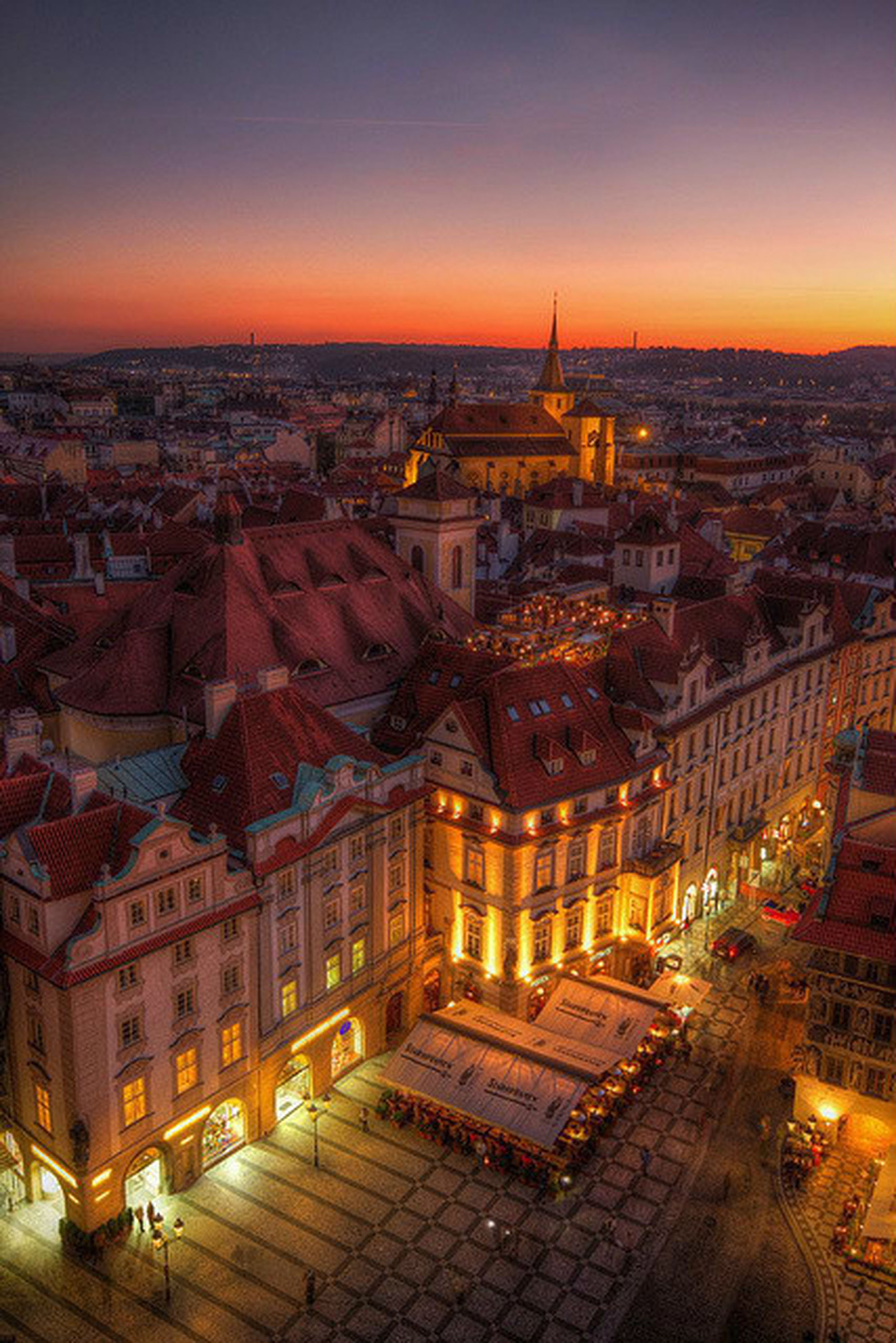 architecture, building exterior, built structure, cityscape, city, high angle view, crowded, residential district, sunset, residential building, illuminated, city life, residential structure, sky, travel destinations, capital cities, famous place, tower, travel, dusk