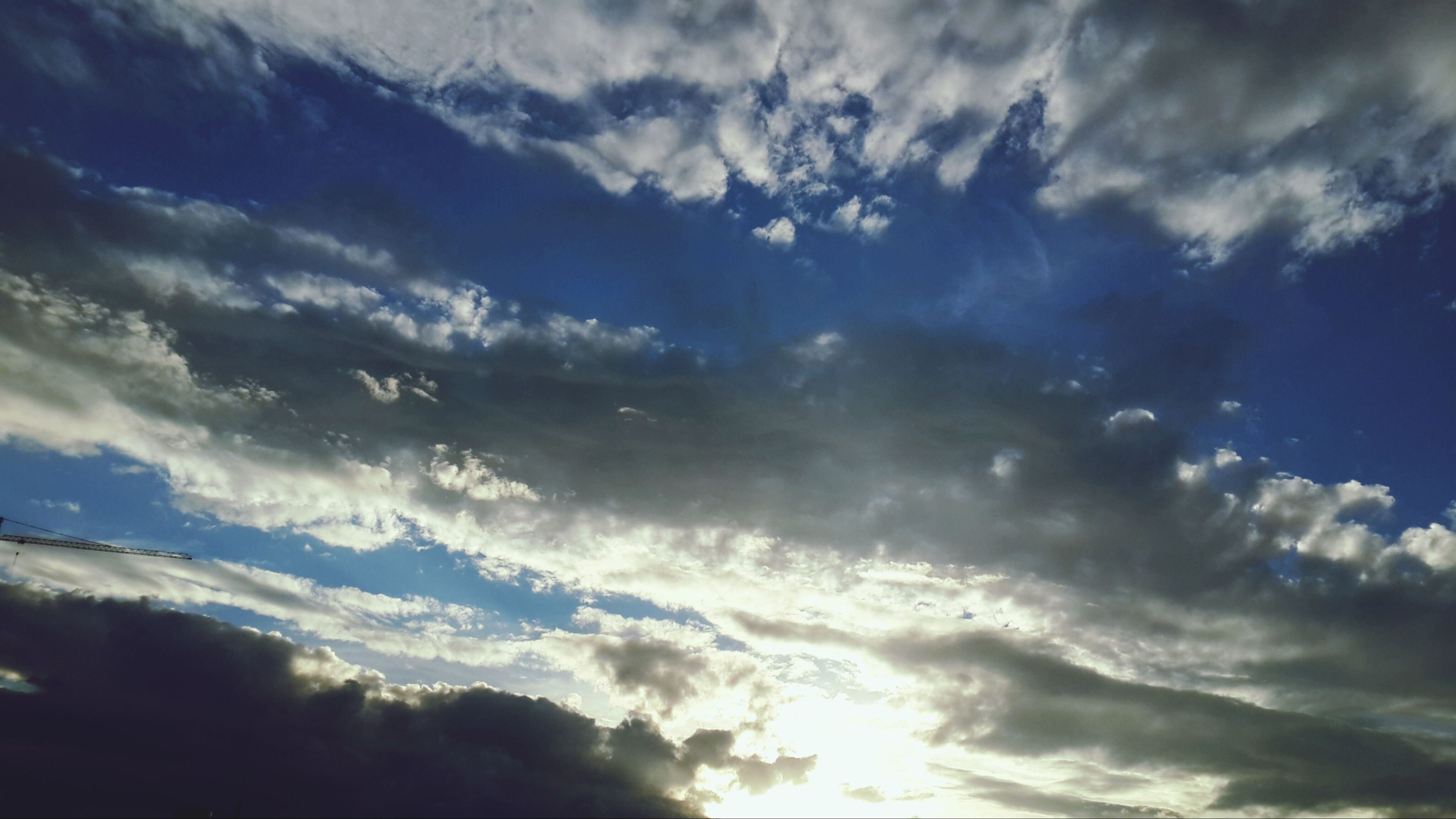 sky, tranquility, cloud - sky, tranquil scene, scenics, beauty in nature, low angle view, nature, cloudy, idyllic, cloud, cloudscape, sunlight, silhouette, sunset, weather, sunbeam, outdoors, sun, no people