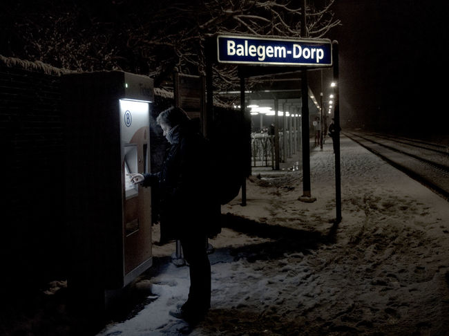 Dark Morning Station Communication Full Length Illuminated Men Night Outdoors People Real People Snow Standing Text Train Two People
