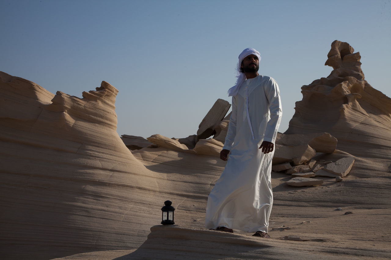 Arid Climate Beauty In Nature Clear Sky Day Desert Full Length Leisure Activity Lifestyles Men Nature One Person Outdoors People Real People Sculpture Sky Standing Statue Travel Destinations Young Adult