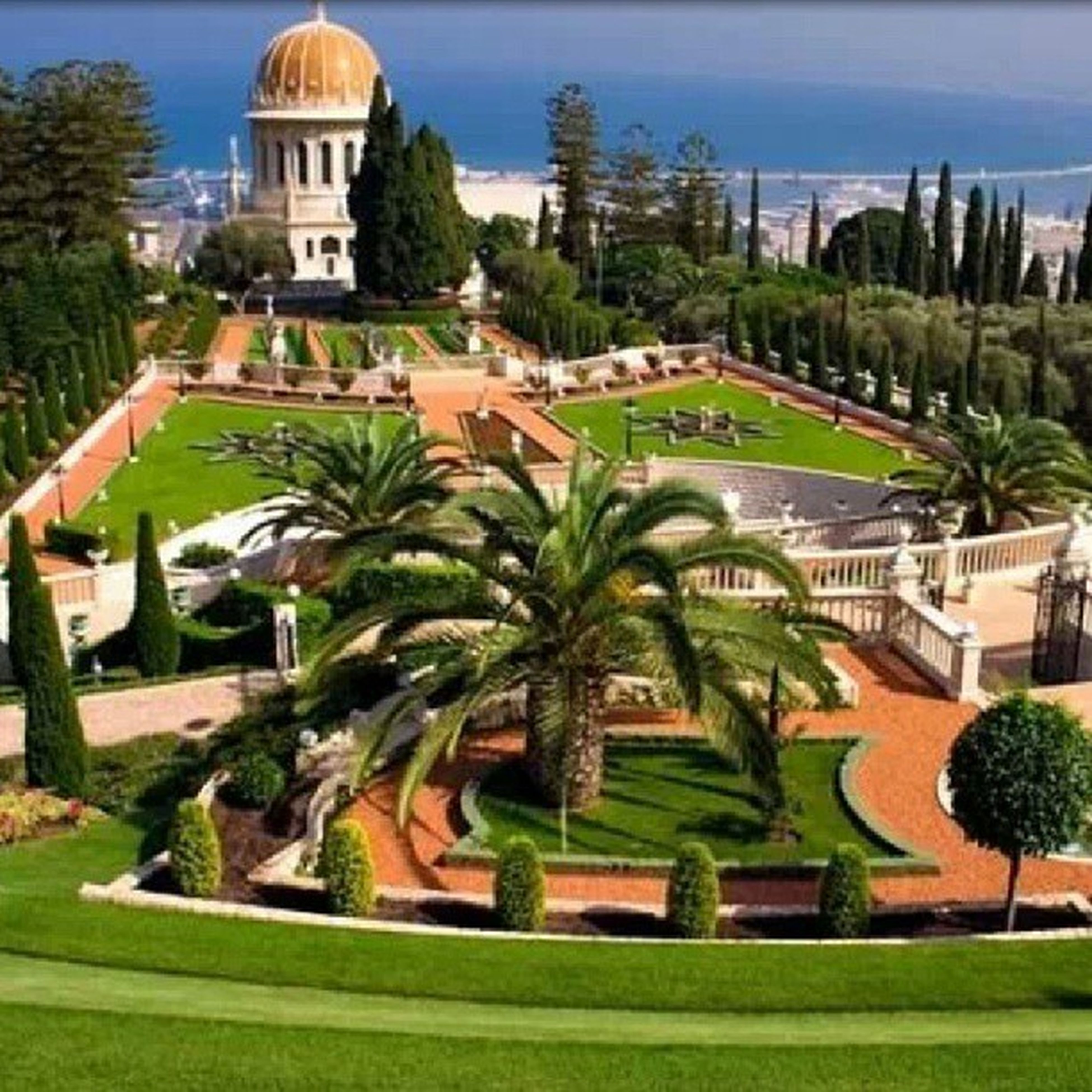 building exterior, architecture, built structure, tree, green color, palm tree, formal garden, grass, fountain, sky, lawn, travel destinations, park - man made space, dome, growth, statue, famous place, plant, outdoors, place of worship