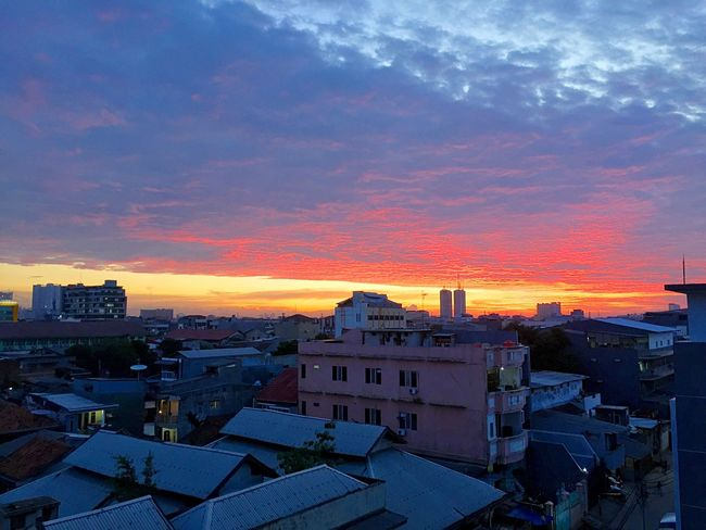 Sunset from my office balcony before the Christmas holiday Mobile Photography IPhoneography Iphone6plus EyeEm Indonesia Sunset Collection Indonesia_allshots Sunset_collection Nature_collection EyeEm Sunset Clouds And Sky EyeEm Best Shots
