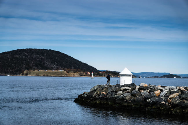 Beauty In Nature Blue Built Structure Cloud Cloud - Sky Day Drøbak Idyllic Island Lighthouse Mountain Narrows Nature Oscarsborg Fortress Rock Rock - Object Rock Formation Scenics Sea Sky Tranquil Scene Tranquility Water Waterfront