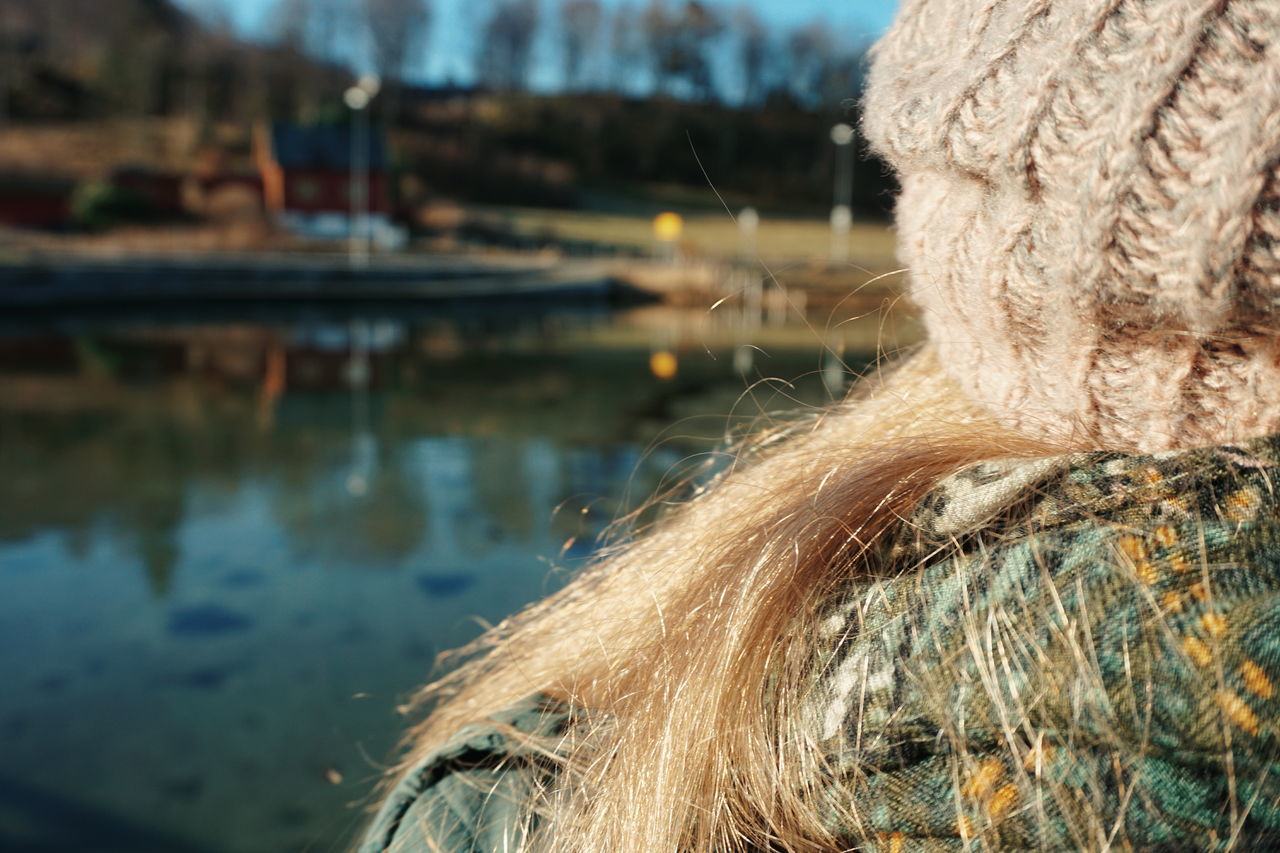 woman looking at the scenery Water Reflection Outdoors Close-up Day No People Nature HEAD Woman Unrecognizable Person Part Of Body Winter Knitted Hat Winter Clothes Lake View