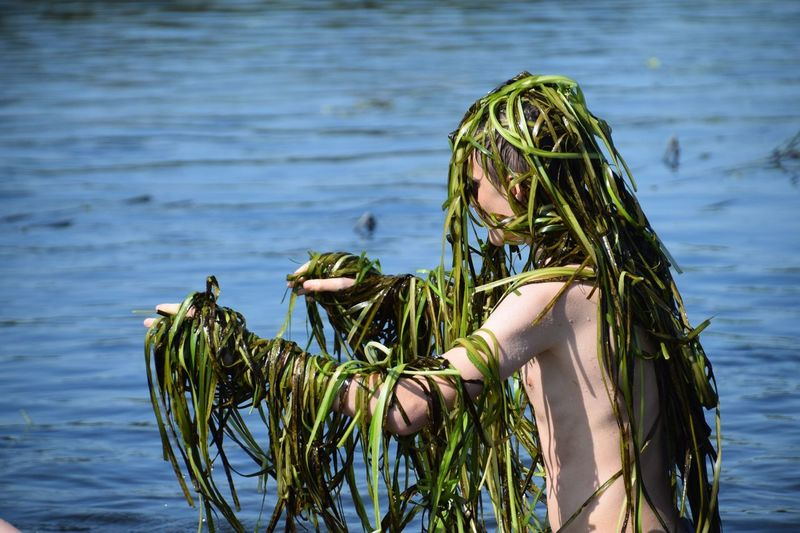 Real People One Person Water Outdoors Lifestyles Standing Day Nature Swimming River River Reeds Scaring Sibling Summer River Fun Swamp Monster Tree Young Adult Sky People