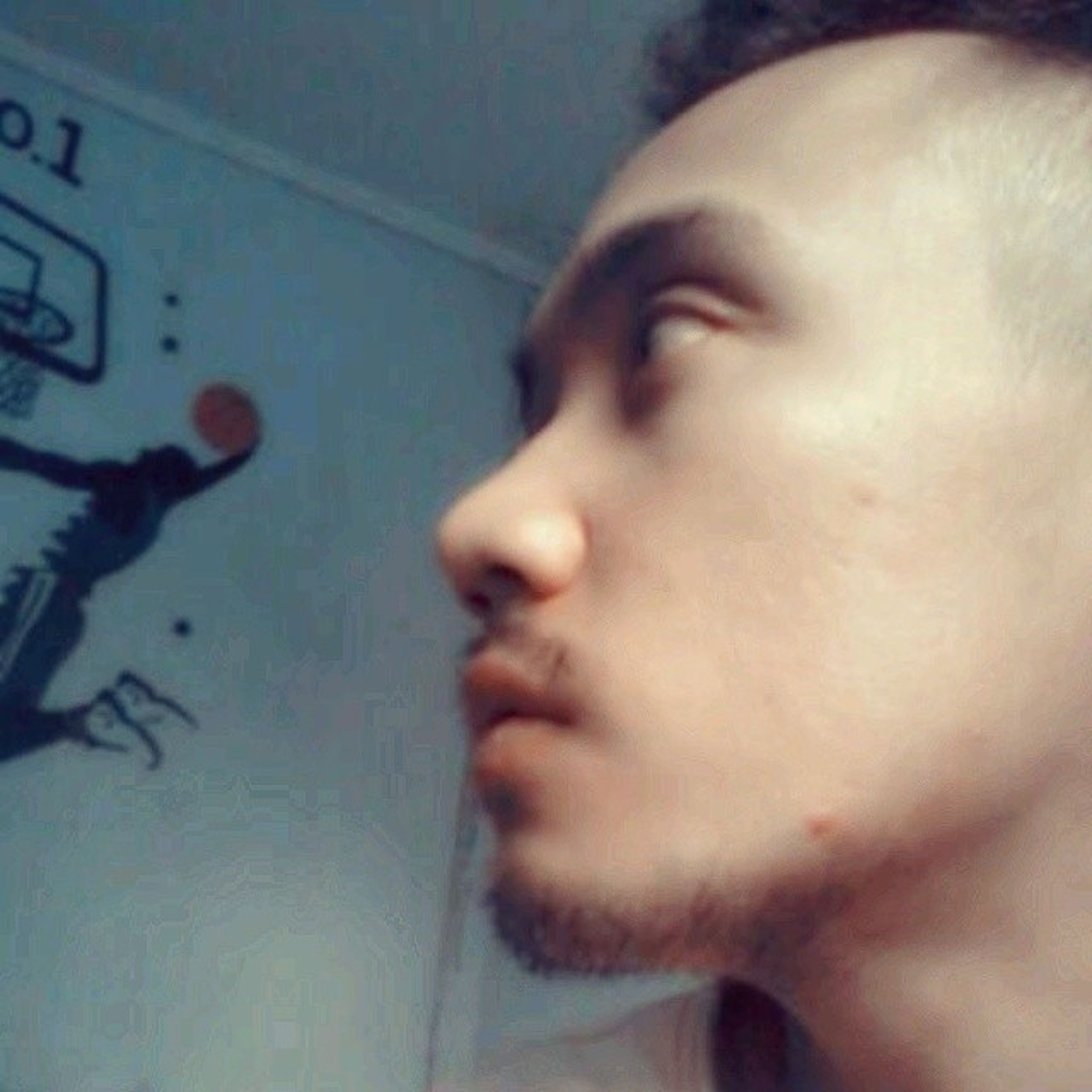 indoors, headshot, lifestyles, close-up, person, leisure activity, human face, young men, young adult, head and shoulders, contemplation, focus on foreground, part of, front view, home interior, looking away