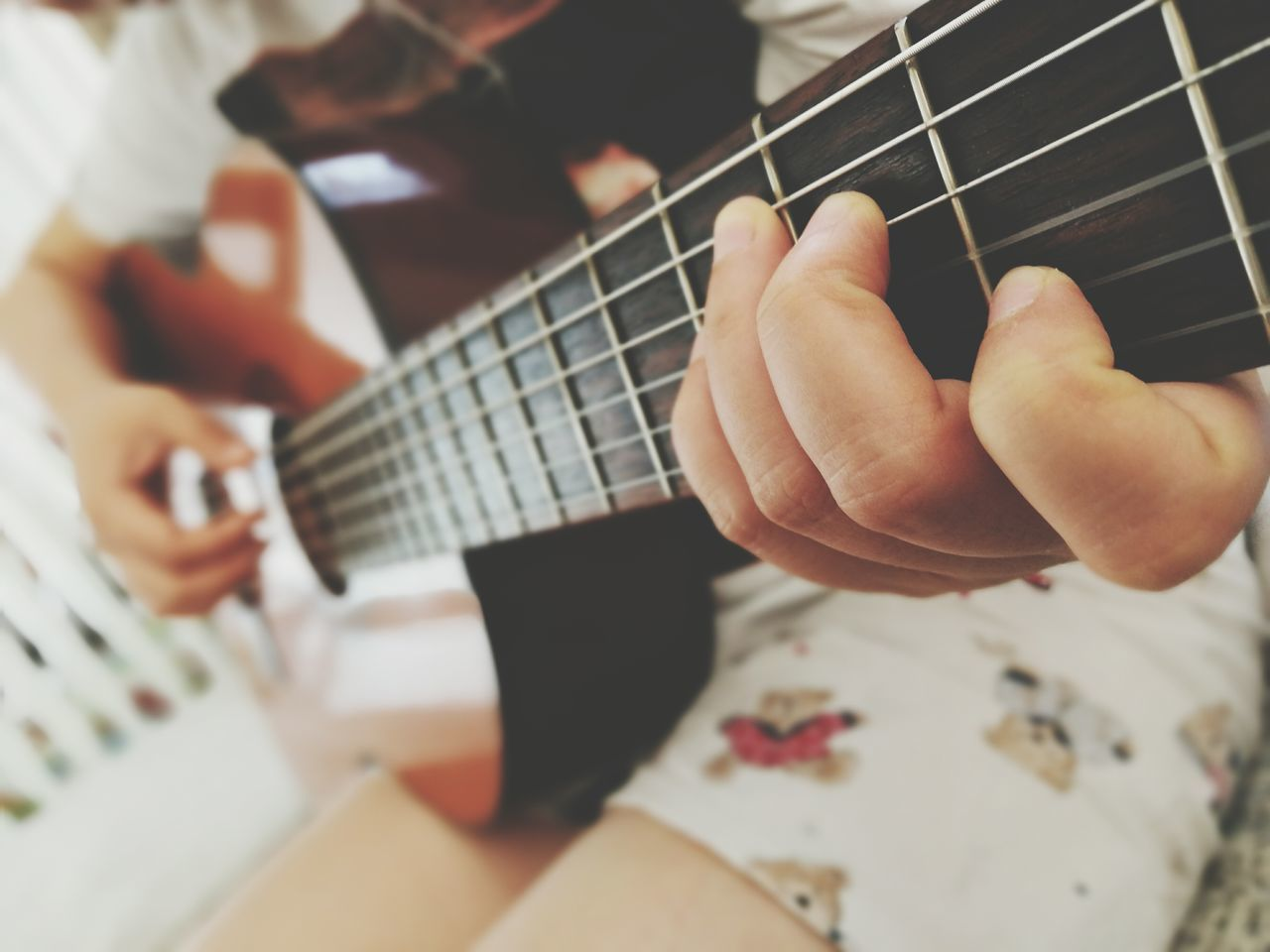 music, musical instrument, guitar, playing, musical instrument string, fretboard, arts culture and entertainment, human hand, indoors, acoustic guitar, musician, one person, leisure activity, plucking an instrument, real people, skill, woodwind instrument, lifestyles, close-up, human body part, classical guitar, electric guitar, day, people