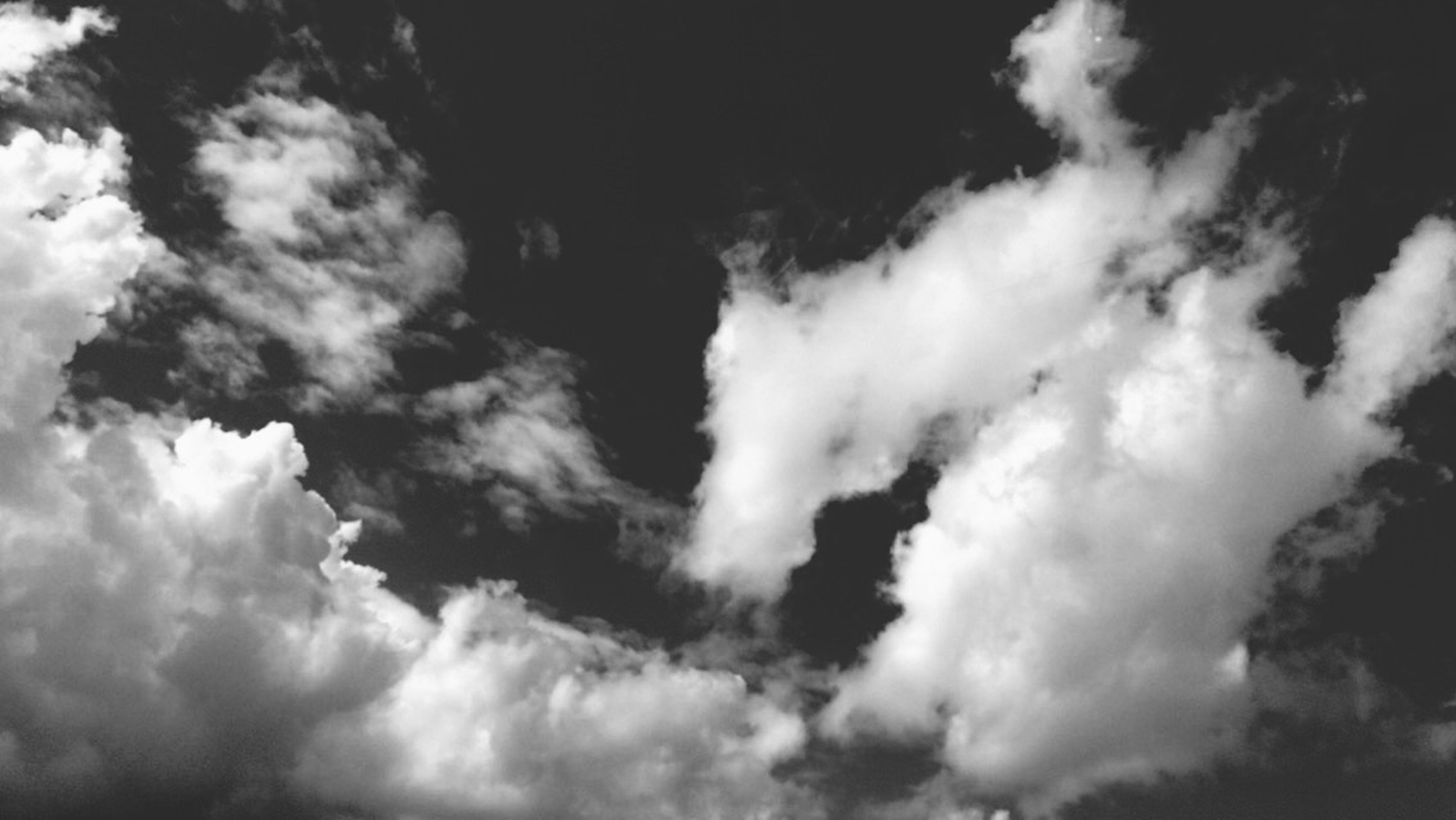 low angle view, sky, cloud - sky, cloudy, beauty in nature, tranquility, sky only, nature, scenics, cloudscape, tranquil scene, cloud, weather, overcast, backgrounds, outdoors, silhouette, idyllic, no people, day