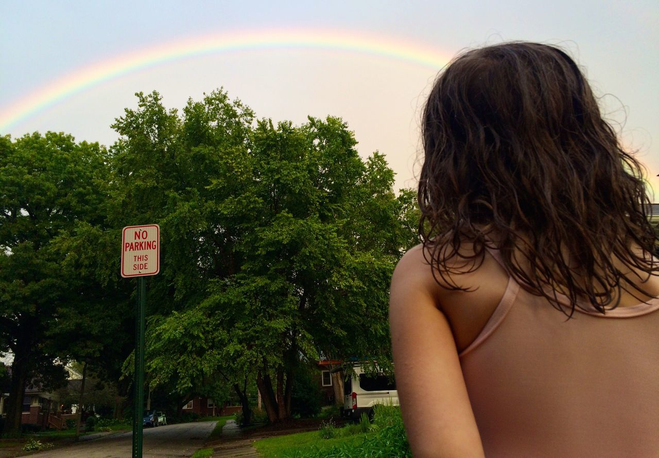 Rainbow Beauty In Nature Person Tranquil Scene Sky Outdoors Non-urban Scene From The Back Elementary Age Wonder In Awe Of Nature One Person People And Places