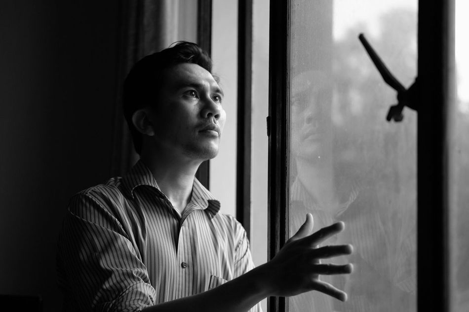 A man standing Real People One Person Indoors  Looking Through Window Young Adult Standing Lifestyles Day Young Women Close-up People Front View Portrait Selfportrait Self Portrait Touching Hand Adult Standing Indoors  Blackandwhite Black And White Monochrome Window Resist