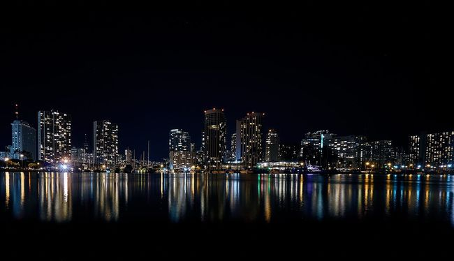 So this is where I live. Downtown Waikiki. Check This Out SONY A7ii Cityscapes City City Life Night Photography Nightphotography Night Lights Ocean Reflection Hawaii Waikiki Sony A7 Mark Ii