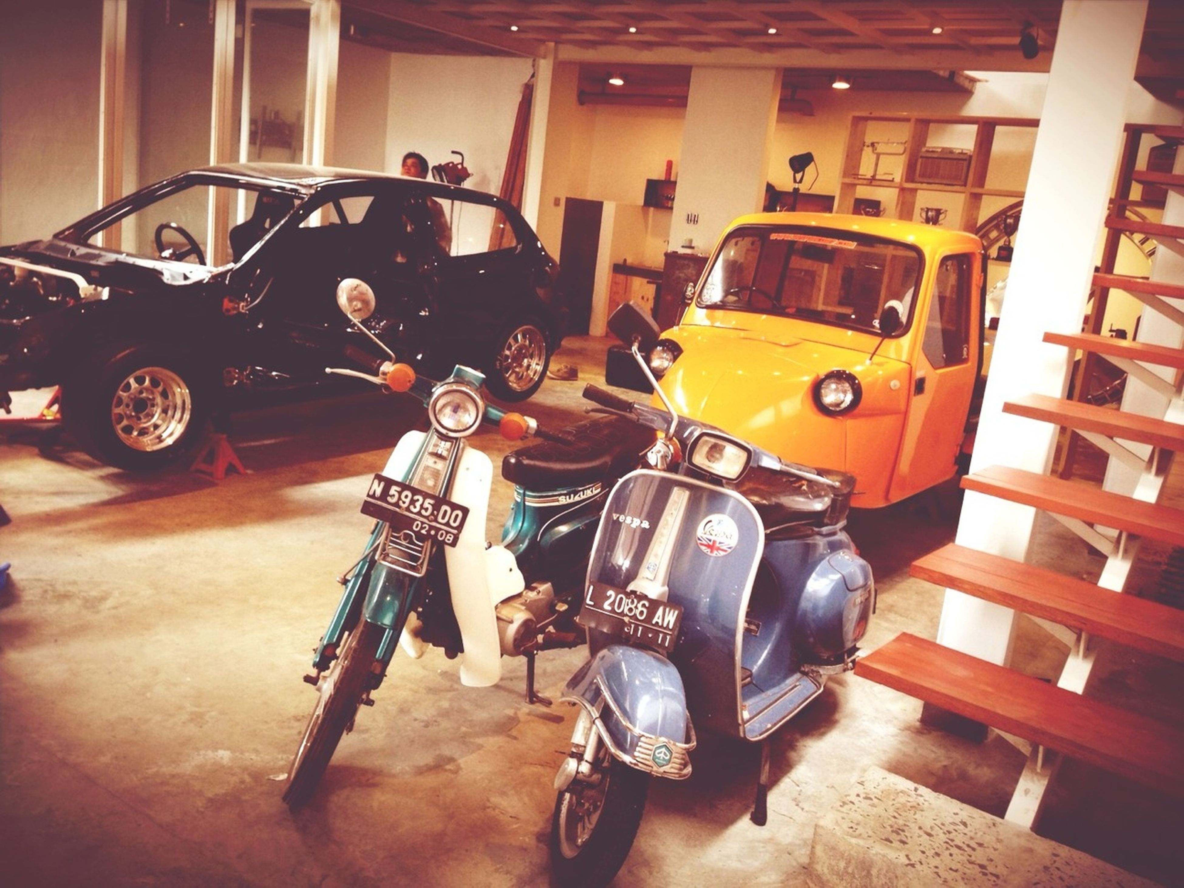 indoors, land vehicle, transportation, mode of transport, technology, bicycle, arts culture and entertainment, retro styled, old-fashioned, stationary, car, parking, music, architecture, equipment, motorcycle, built structure, men