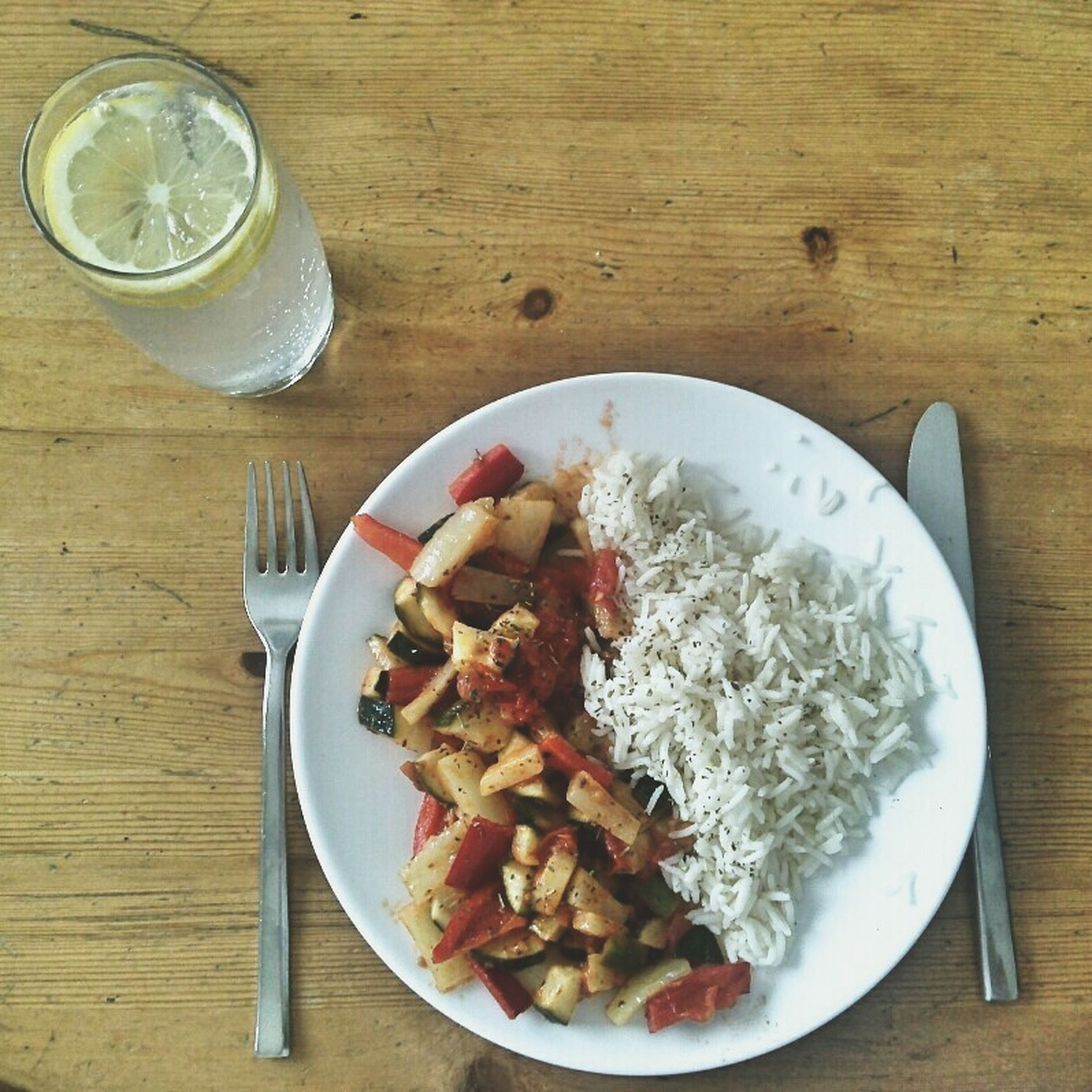 food and drink, food, freshness, table, indoors, ready-to-eat, plate, still life, healthy eating, serving size, meal, served, bowl, high angle view, drink, drinking glass, fork, indulgence, meat, spoon