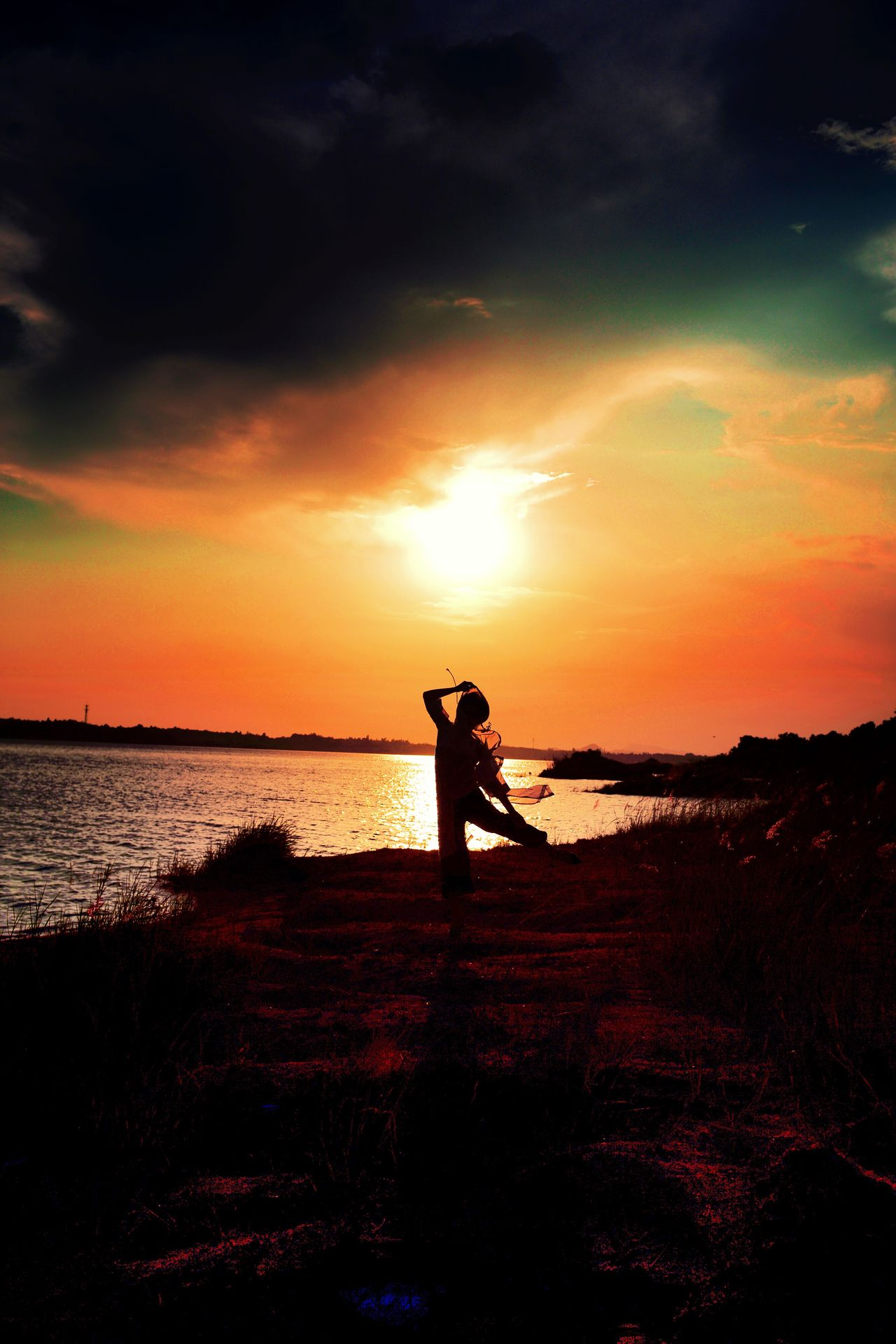 Sunset Silhouette Sky Orange Color Nature Beauty In Nature Full Length Sea Water One Person Cloud - Sky Beach Real People Scenics Standing Lifestyles Tranquil Scene Horizon Over Water Leisure Activity Outdoors