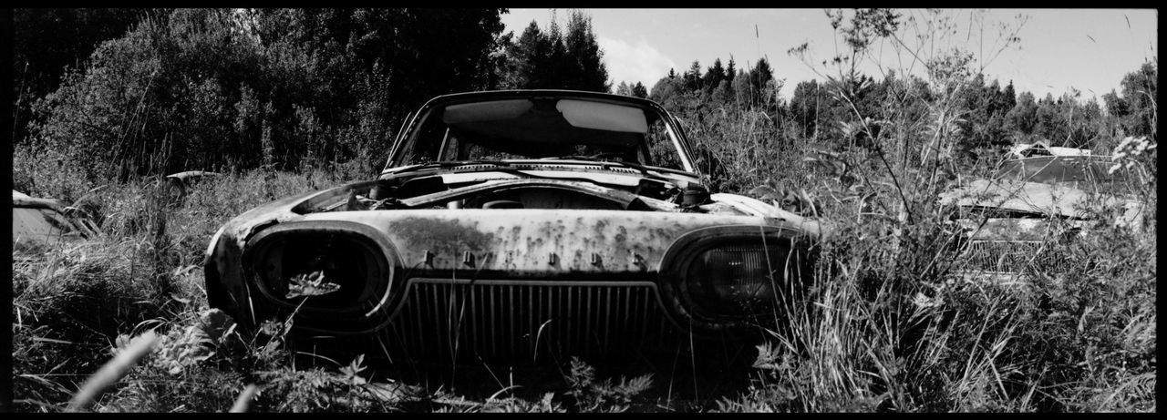 The black dystopia of Båstnäs 50ies Cars American Cars Analogue Photography Apocalypse Black And White Broken Cars Båstnäs Båstnäs Car Cemetery Båstnäs Töcksfors Car And Trees Car Cemetery Cars Dystopia Forrest Metal And Rust Moss Muscle Cars Nature No People Panoramic Photography Scrap Cars Sweden Travel Traveling Vintage Cars