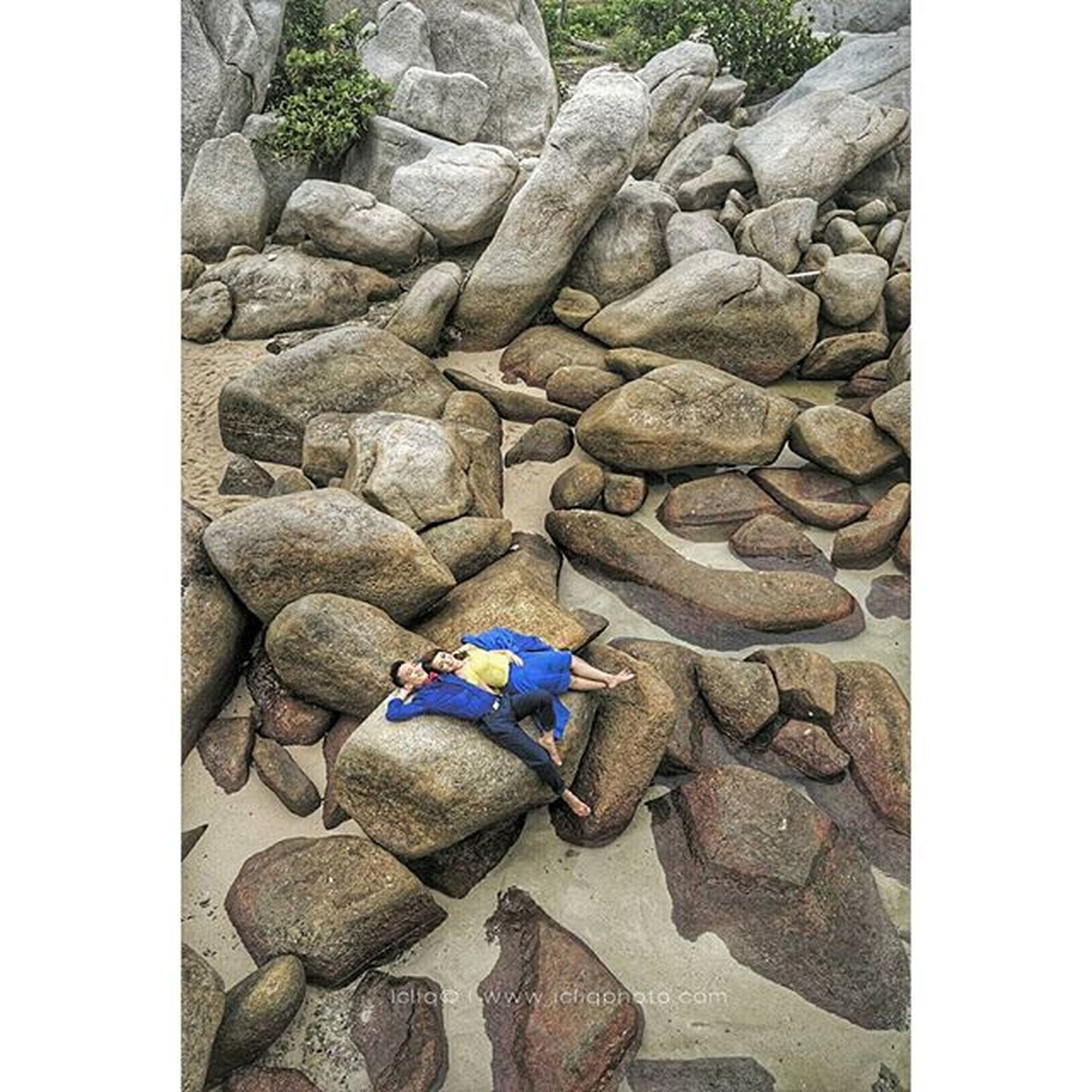 transfer print, auto post production filter, rock - object, stone - object, high angle view, stone, abundance, outdoors, day, stack, large group of objects, textured, sunlight, nature, pebble, rock, tranquility, no people, rock formation