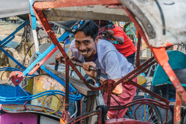 pedicab driver Waist Up Three Quarter Length Casual Clothing Front View Day Outdoors Large Group Of Objects Smile Portrait People Street Photography Men Pedicab Human Interest
