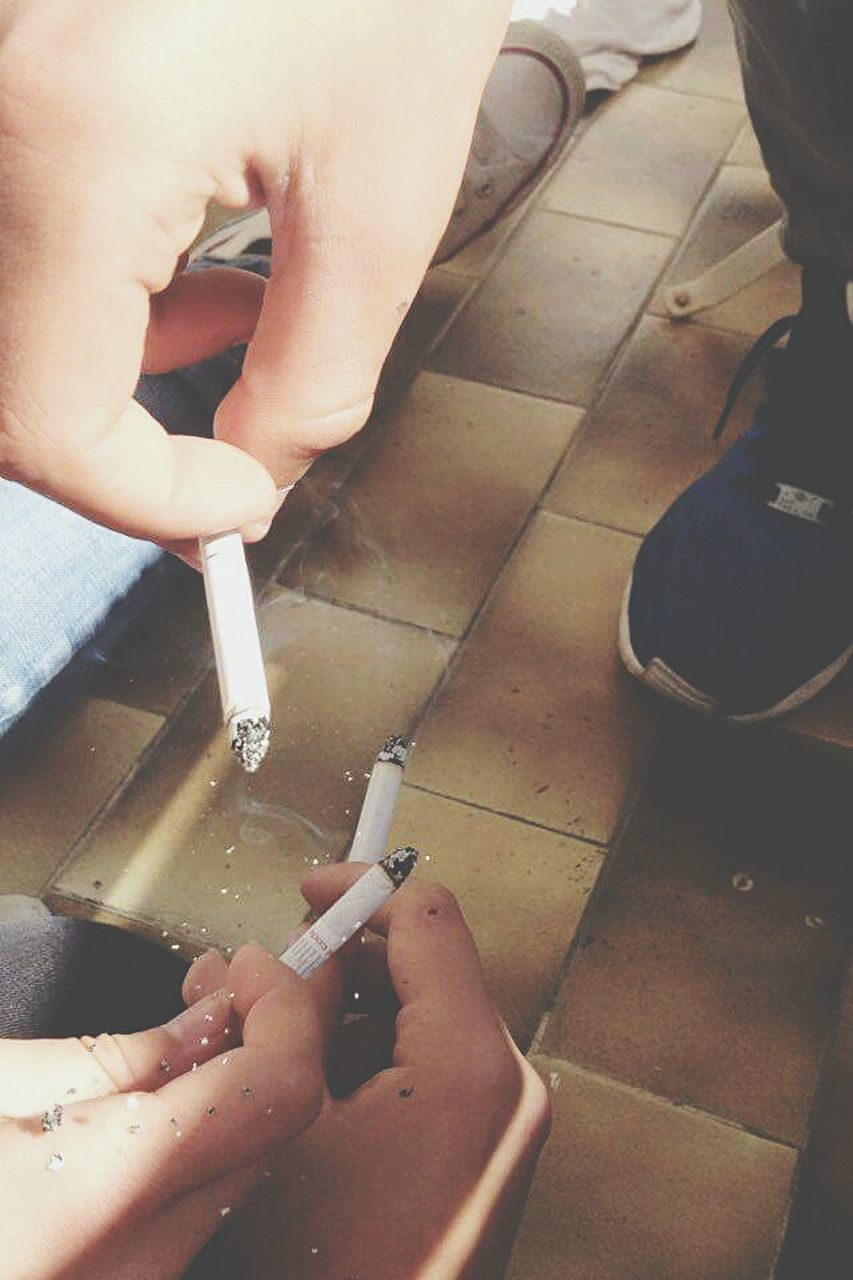 addiction, smoking issues, bad habit, cigarette, human body part, human hand, social issues, danger, risk, smoking - activity, smoke - physical structure, cigarette butt, human finger, real people, one person, ashtray, human leg, cigar, low section, indoors, men, close-up, day, adult, people