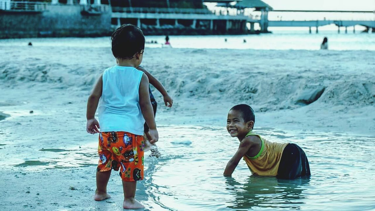 Sandkid Child Boys Males  Water Beach Happiness Fun Joy Summer Wet Two People Vacations Smiling Lifestyles Enjoyment Cheerful Back Sea Playing Childhood