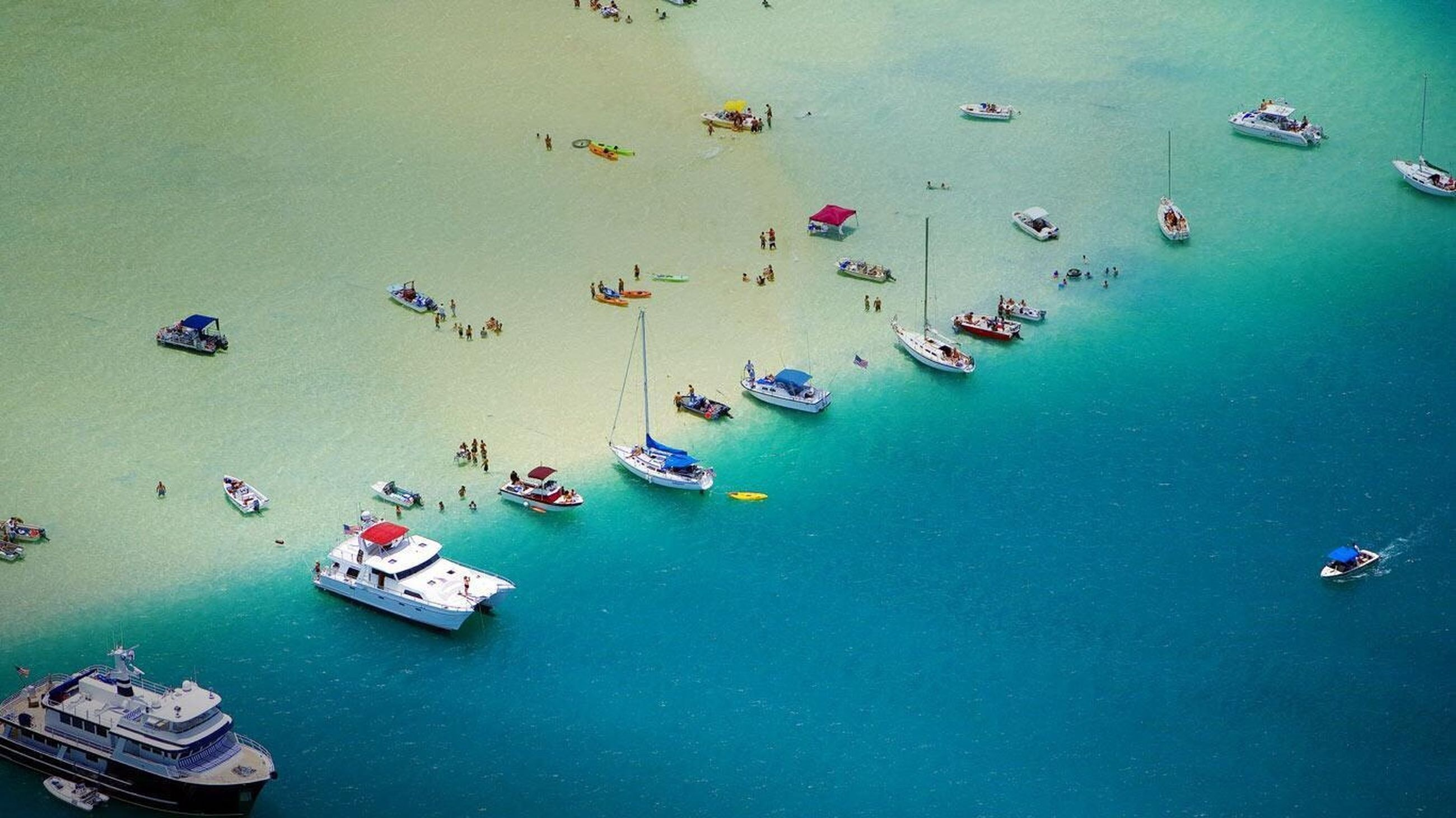 nautical vessel, transportation, water, boat, mode of transport, high angle view, large group of objects, moored, sea, blue, waterfront, abundance, travel, in a row, copy space, day, no people, outdoors, multi colored, nature