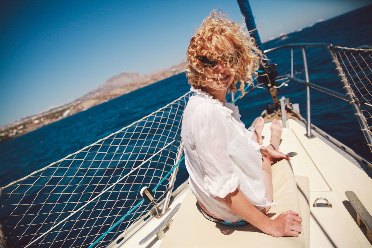 Beautiful stock photos of porträt, 25-29 Years, Blond Hair, Blue, Boat